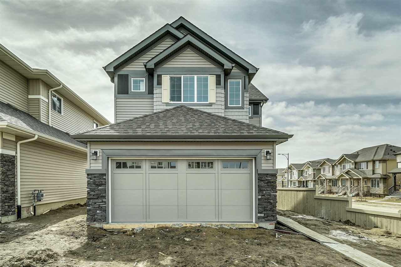 Welcome to Edgemont. Small town feeling in the big city of YEG! Incredible views from the back deck!  The Tahoe II built by Daytona Homes is a 1758sqft wonderful family home ? 3 beds, 2.5 baths! Over sized double garage - A spacious foyer welcomes guests. You will love the open concept style ? laminate & tile flooring throughout & 9 foot ceilings on the main floor. The Kitchen is beautifully finished with quartz countertops, beautiful cabinets, a prep island, an extended eating bar, ceramic backsplash, a pantry & a spacious breakfast nook! The large living room features a gas fireplace on side wall, the private den/home office & powder room complete the main floor. Retreat upstairs to the spacious master suite, which features a 4 piece ensuite (2 sinks & extra large shower) & a walk in closet. Both children's rooms are a good size, the large bonus room is the perfect place to relax with the family, upper laundry & 4 piece bath complete this level.