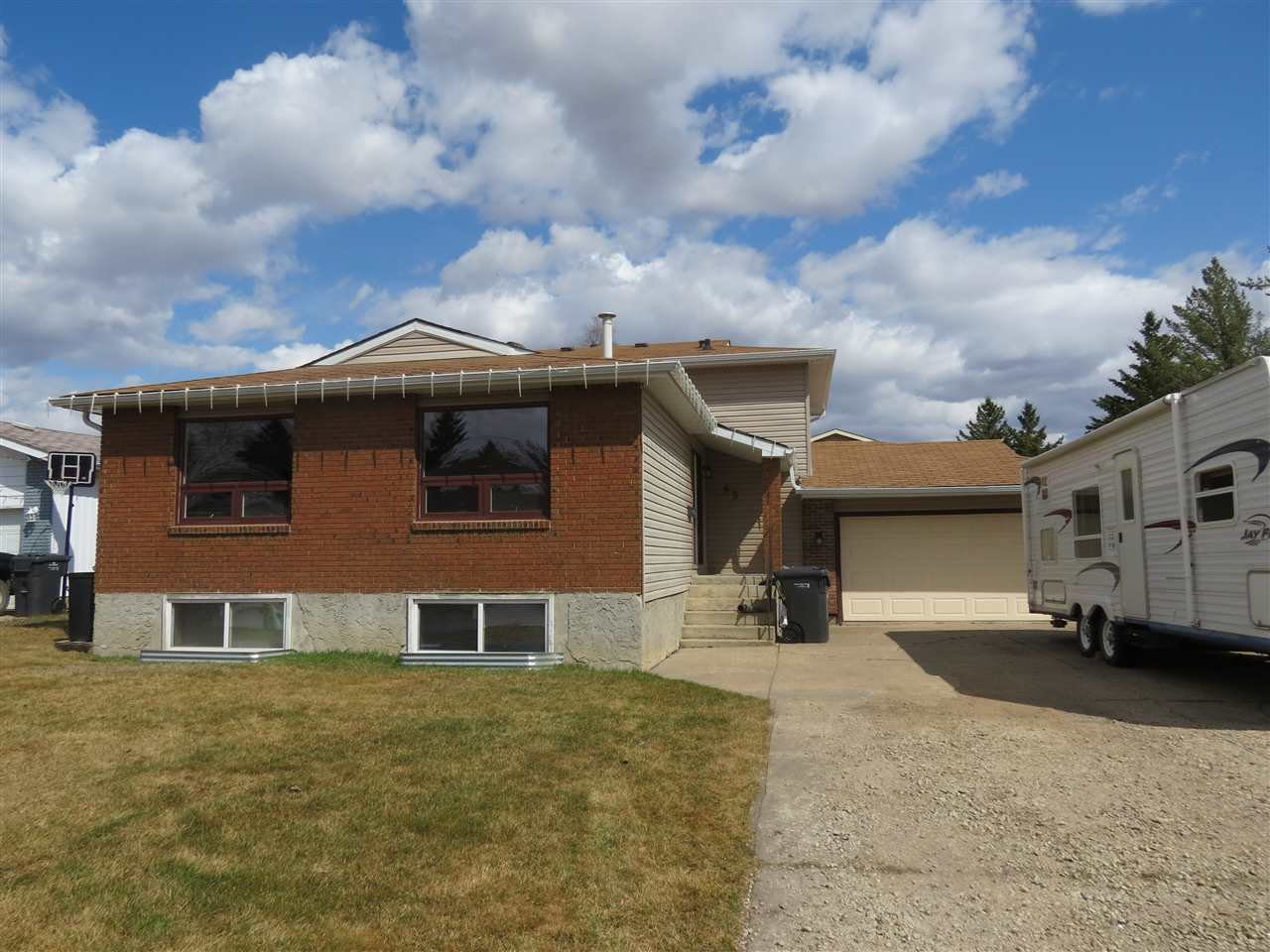 This 4 level split with 3 levels above grade with walk out on 3rd level to large back yard. Located in the hamlet of Cardiff just 15 minutes north of St Albert and close to Cardiff Golf and Country Club. 5 bedrooms and 3 bathrooms and fully finished 4th level with Rec room 5th bedroom and cold storage. The main level has updated Kitchen in 2011 with hardwood flooring throat and leads to a sunken family room with a brick fireplace. The main also has a dining room and a living room . Other upgrades include windows, siding, furnace and HWT.