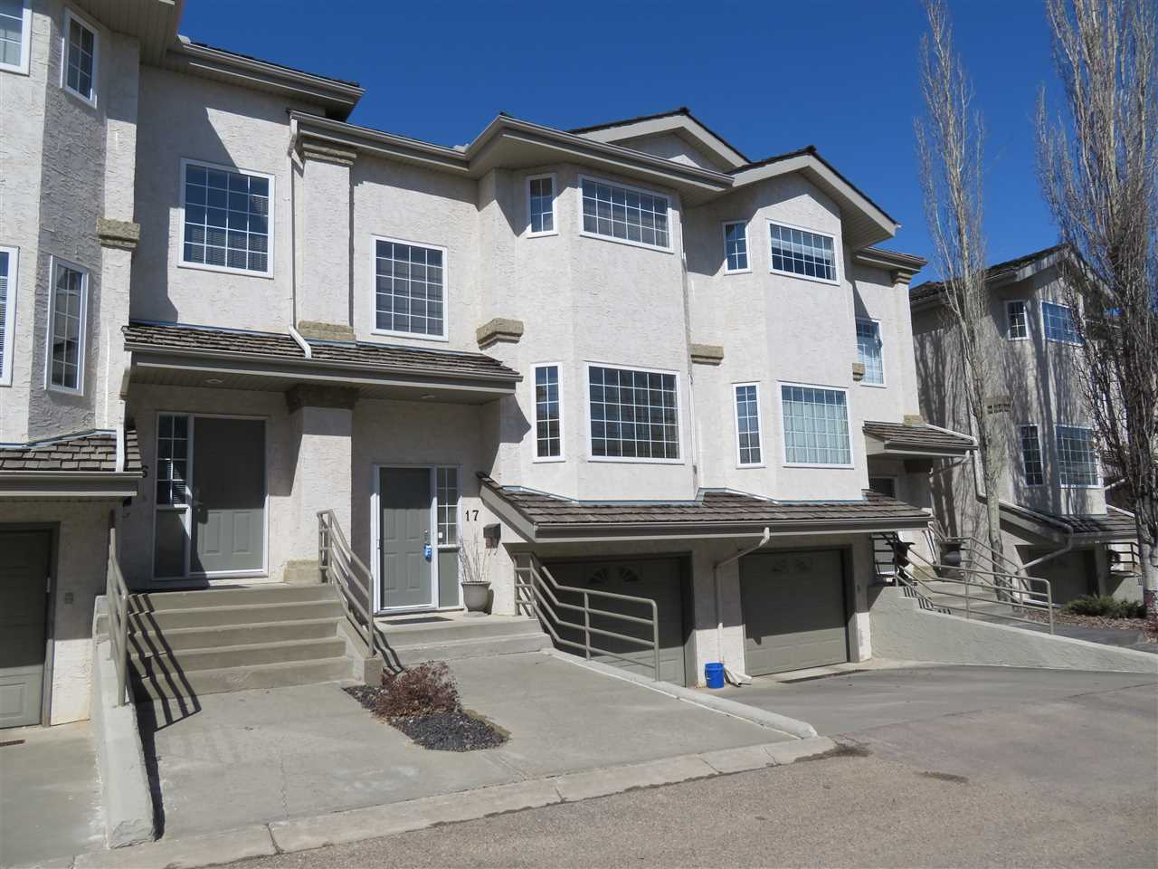Absolutely gorgeous and upgraded townhouse in the heart of Carter Crest! This unit features over 1400sqft + a developed bsmt and tandem double attached garage! The main lvl greets you with a lrg living room w/gas fireplace, dining room, ½ bath and a spacious kitchen with lrg island c/w quartz counters and updated appliances. Light H/W flooring is found throughout the main floor, stairs and upper level. Need to unwind? Look no further than your private west facing deck where you can relax and enjoy the sunsets every day! The second floor features a laundry space and 2 large master suites each with walk in closets and their own 4pce ensuite! The basement is developed with an additional den/bdrm featuring brand new carpet! Many upgrades and updates on this lovely home including the newer water tank, central AC, updated roof, central vac, newer sump pump and updated toilets. Ideally located close to all major amenities and quick access to the main traffic corridors! Home shows very well + ready to move in!