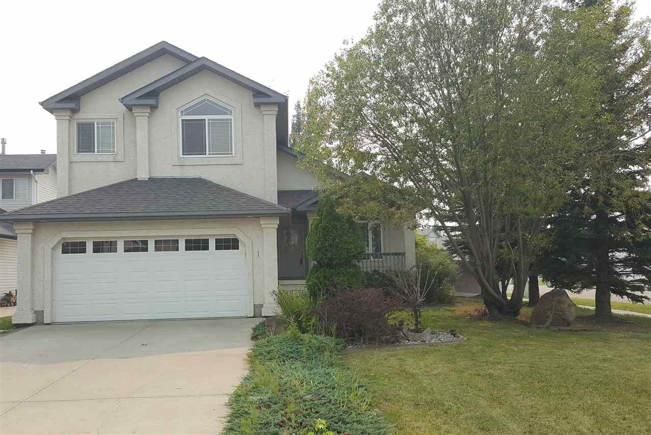At the edge of prestige Colonial Estates for easy access to Edmonton and area. Very nice curb appeal & awesome mature private back yard with large deck & shed. Impressive spacious front entry. Brand new gleaming hardwood floors throughout, gas fireplace in living room, stainless steel appliances in kitchen & walk up eating Island. Vaulted ceilings to give open floor plan look more spacious. Corner nook, formal dining room, & main floor laundry. Beautiful staircase leads to large master bedroom with jetted tub & separate shower & walk in closet. Basement has 2 bedrooms, rec room & RI bath. Shingles replaced in 2016. Central air & alarm system, front porch & more