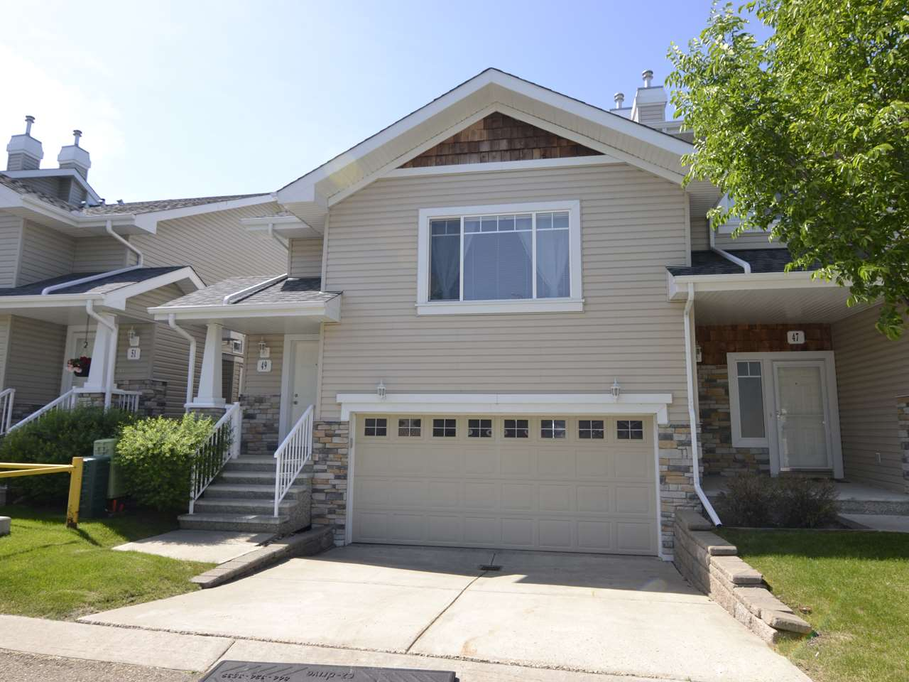 This townhome in Edmonton's South West is so bright and inviting you won't want to leave! Located just minutes from the Terwillegar Rec Centre, Currents of Windermere, and the Henday, this lovely home has a layout you?ll love - main floor is home to open concept living, kitchen, and dining area, complete with 9' ceilings, built-in desk, fireplace, hardwood floors, and walk-in pantry; it also features main floor laundry and guest bath, and a large master suite with vaulted ceilings, his and hers closets, and ensuite bath. The lower level adds two more bedrooms with large windows to your space, lots of storage, and an additional full bath. The double garage is quite large and one of your favorite places this summer is sure to be the patio and deck - whether you love to BBQ or lounge outside, this is the perfect spot to get some sun! This unit offers the best of both worlds, no exterior maintenance, and yet nearly 1500 square feet of developed living space! Don't miss it!