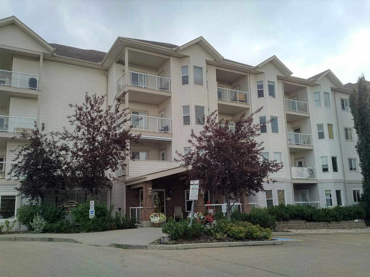 EXCELLENT OPPORTUNITY TO ENJOY AN ACTIVE ADULT LIFESTYLE AT A GREAT PRICE!  If you're 55 or over, here's a condo you won't want to miss.  Located in the popular and desirable complex of Central Park Estates in NE Edmonton and a fantastic location close to lots of shopping, transit, LRT, medical centre, legion, and so much more.  3rd floor, TWO bedroom, TWO full baths, with open concept floorplan.  There's also TWO PARKING STALLS (one UNDERGROUND WITH STORAGE CAGE and the second is an OUTDOOR STALL close to entry).  The kitchen features oak cabinetry and a breakfast bar for casual dining, good sized living room with garden door to balcony, master bedroom has a walk-through closet and a full en suite.  There's also a big storage room with stackable washer and dryer.  The complex offer wonderful amenities, such as:  a theatre, exercise area, social room, games room, car wash, plus a heated pedway to the Miller Crossing Care Center next door.  Extremely well managed complex.