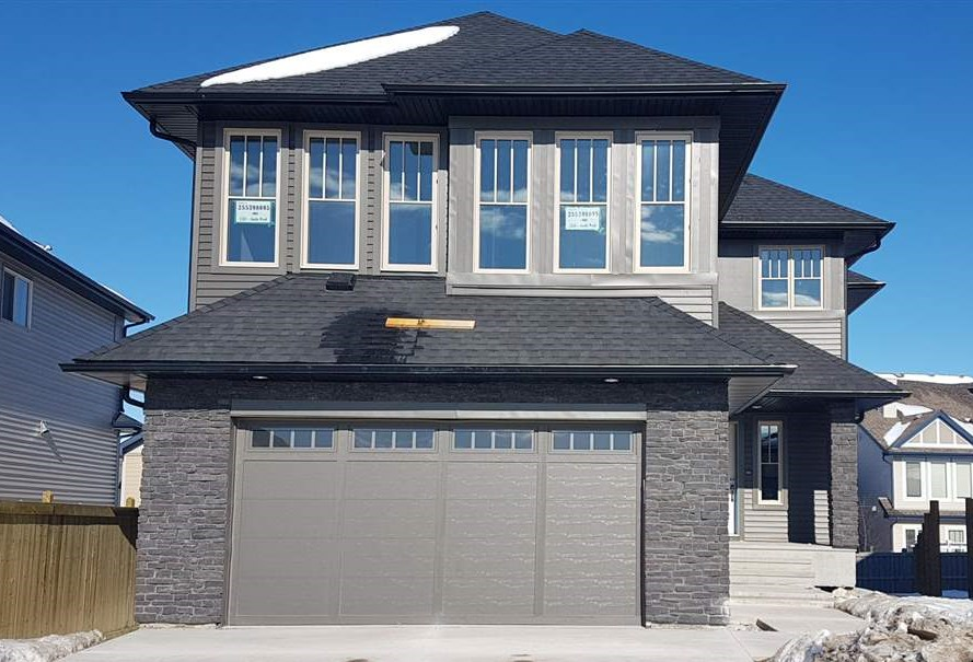 STUNNING Brand New, 2 Storey Home is ATTRACTIVE & MODERN both Inside & Out, Features 2535 sqft of Luxury Living Space, Excellent Curb Appeal with Stone work, Pie Shaped Lot, Double Attached Garage. Main & Upper floor boasts 9 Ft Ceiling, 8 Ft Doors, Inviting Living Room, Large Windows, Gorgeous Fireplace with Custom Shelving, Gourmet Kitchen,Quartz Counter-Tops; Stainless Steel Built in Appliances with Gas Cook Top; Centre Island; Ample Cabinets; Walk through pantry; Glass Tiled Back splash; Good sized Dining Area, Main floor Den / Flex Room, Full Bath.Upstairs offers Spacious Bonus Room, Master Bedroom with 5 piece en suite & Walk in closet with Custom Shelving, 2 Additional Bedrooms & Laundry.Builtin Speakers with 4 Zones Volume Control, Cat5 Wiring, Upgraded Lighting Fixtures, Glass Maple Railing, Rear Deck, HRV, Triple Pan Windows.Separate entry to basement for feature suite. Close to golf course, shopping, public transit, and enjoys easy access to Henday. Come and make your dream true. Shows10 !!!