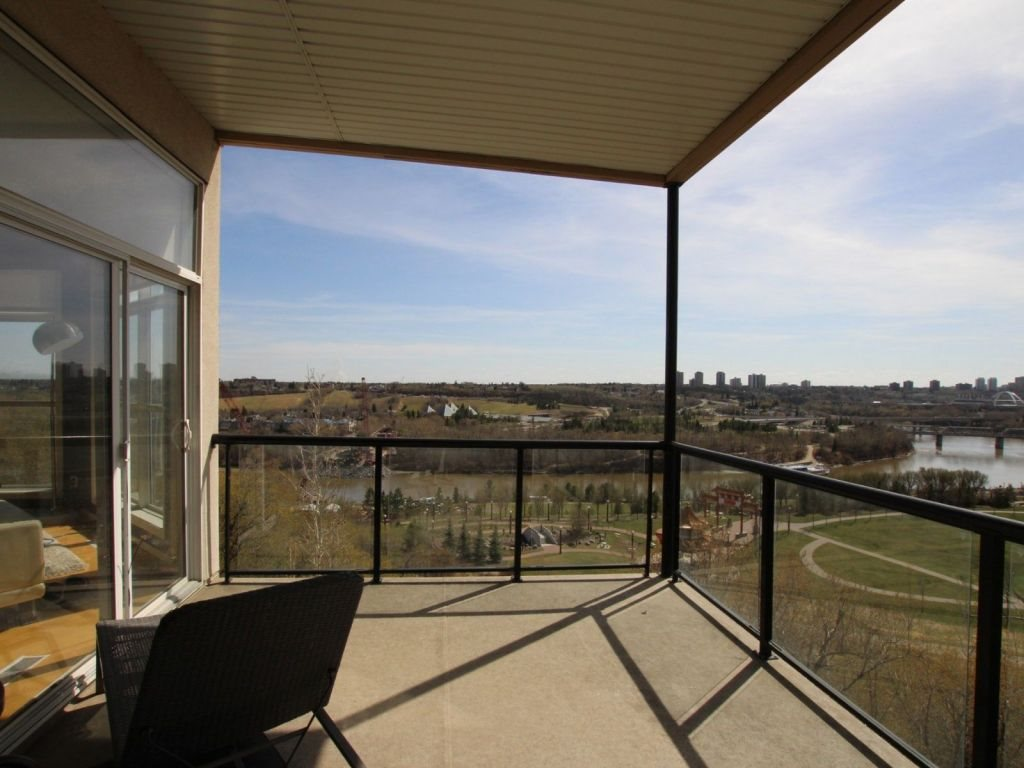 SPECTACULAR RIVER VALLEY VIEW! This spacious 2 bedroom, 2 full bath condo in Downtown Edmonton has an absolutely incredible, unobstructed view of the River Valley and the East side of Downtown.  This 4th floor unit has a unique open-concept layout with 10 foot ceilings. The unit is filled with natural light, year-round, flowing in from the 3 large bay windows of its southwest-facing living room. Soak up the sunshine on the oversized balcony. Enjoy access to the patio from the living room and the master bedroom. Large master bedroom also includes a 4-piece en-suite with soaker tub, and walk-in closet. There is a spacious second bedroom with a full closet. The open-concept kitchen/living area is massive - great for hosting! It features an island with a large bar top, side-by-side sink, and plenty of cabinets and counter space. This unit also includes 2 titled parking stalls and storage