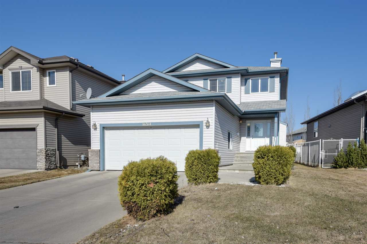 This very well maintained 2 storey in Hollick-Kenyon shows beautifully w/ and exceptional floor plan. Be impressed with the nice size foyer, the beautiful hardwood & ceramic floors throughout the main area. The living room is a great size along with the dining room area and the outstanding well maintained oak kitchen. Also comes with a large eating area and an awesome pantry. Enjoy the gas fireplace in the family room for those cooler days and the large deck for all those summer months, which is PERFECT for entertaining. The master bedroom is extremely spacious w/ a nice size walk in closet, a large en-suite w/ his and hers sink and a nice jetted tub. Two more excellent size rooms complete the upstairs. Basement is partly finished with a large rec room which would be great as a movie/rec room, ideal for family gatherings. Other features include main floor laundry, BRAND new paint throughout, double attached garage and shed. Close to shopping, Anthony Henday and LRT station. Click link for Virtual Tour.