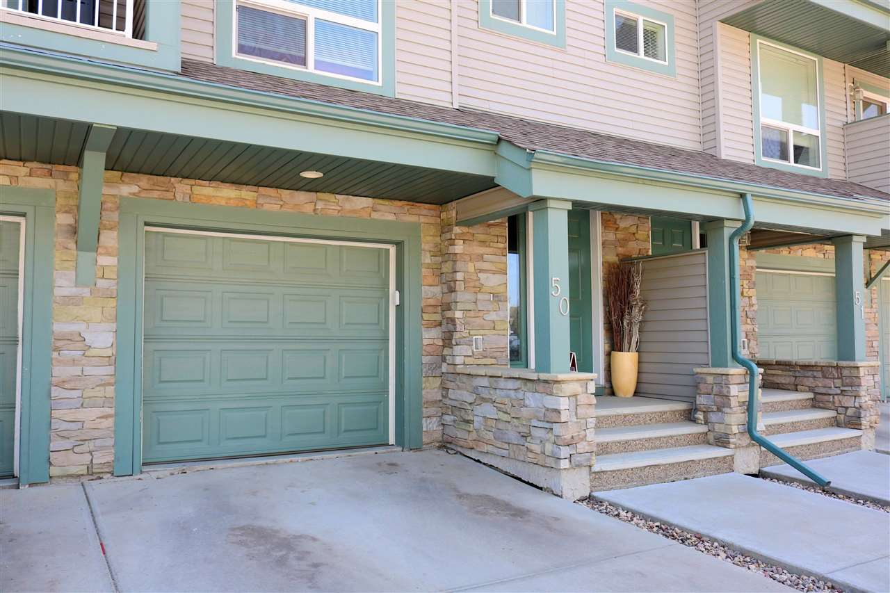 WONDERFUL Townhouse located in the DESIRABLE RUTHERFORD Area. This 1291 sqft  home is spacious, bright with fairly new paint, lighting and laminate flooring through-out the entire main floor.The main floor is open and boasts a large living room, spacious kitchen, movable island and stainless steel appliances with 2-piece bath and walk-out balcony with Natural gas hook up for barbecue. Upstairs has 3 nice size bedrooms, 2 baths and a private sunny balcony with green space. The master bedroom has a walk-in closet and 4 pce ensuite. Carpet runs up the stairs and through- out the bedrooms. Also the washer and dryer are upstairs with storage. Bike and walking path is just out side your front door and goes for miles. The Solaris complex is walking distance to both schools in the community and a short drive to all of the major amenities and Anthony Hendey. Condo fees incluse landscape, snow removal and exterior maintenance. The home is perfect for a First time buyer or a young family. Book your showing today!