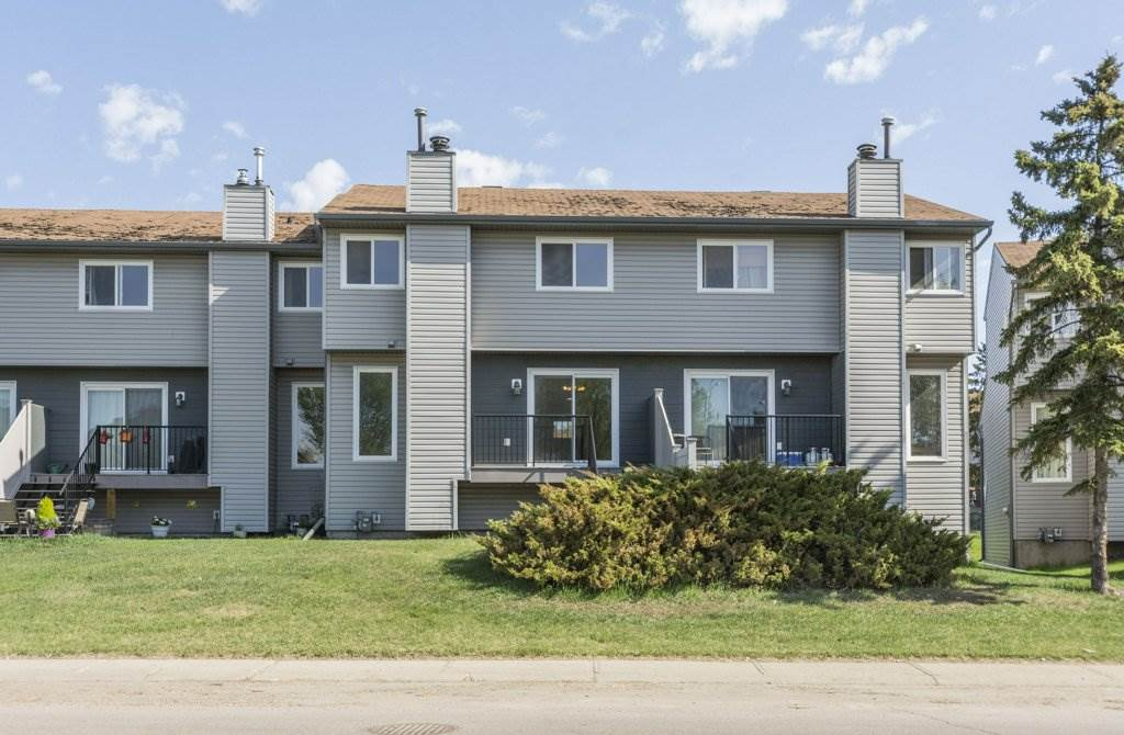 GREAT STARTER HOME or INVESTMENT PROPERTY: JUST REDUCED - JULY 20/18 -  $204,900.00: Well maintained 2 Storey, 3 bedroom, 1½ bath Townhouse: All  major exterior upgrades have been recently completed ? new siding, new windows, new decking, and new shingles. On the interior the owner has done a complete repainting , installed new cabinets, counter tops and back splash in kitchen, new laminate flooring throughout, new tubs and toilets, LED lighting, hot water tank (3 yrs. old), and carpets on the stairs. Other features include single car garage with parking apron in front, visitor parking directly across from front door, front veranda and rear decking made of low maintenance material, 3 bedrooms, 1 full bath on second floor and 1/2 bath main floor, wood burning fireplace, and patio. Close to schools, shopping, public transportation, golf course, a stone?s throw from both the Whitemud and the Henday?Do not miss out; this unit is a must see; book your private showing today; quick possession available.