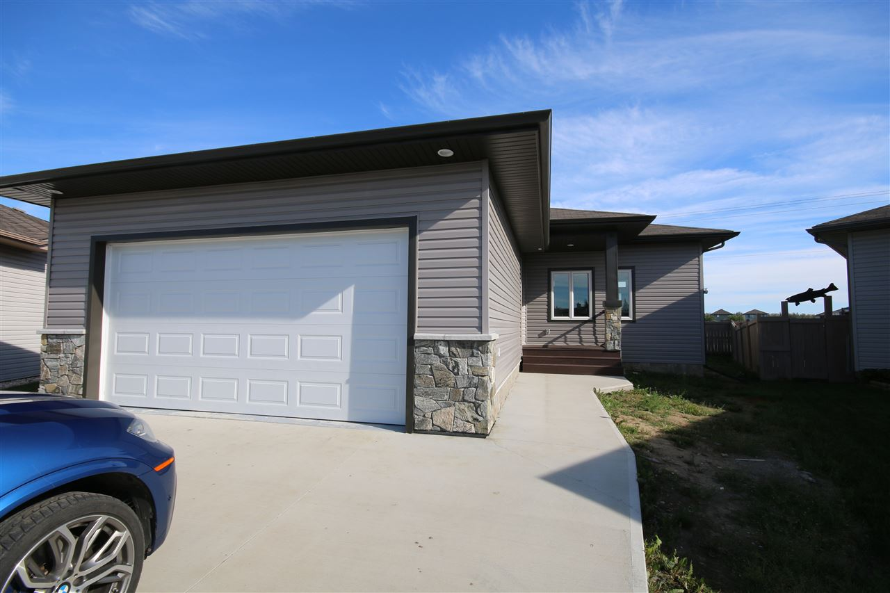 This beautiful 1487 sf bungalow is in the Willow Park community of Stony Plain, in a cul-de-sac location & offers a 22x23 attached garage & exceptionally large south-facing back yard. The main floor offers a lovely foyer w/ spacious den nearby & opens nicely to a great room w/ corner gas fireplace & lovely kitchen w/ granite countertops, centre island w/ wine display rack, pendant lighting, dark cabinetry w/ tiled backsplash & bright breakfast nook w/ a view of the back yard as well as main floor laundry & master suite. Perfect for the empty nester, the master bedroom features a gorgeous 5-piece ensuite w/soaker tub, tiled shower, 2 sinks & a large walk-in closet w/ built-in cabinetry. Throughout the main floor is warm, engineered flooring, 8? interior doors & 10? ceilings & wide white crown moulding. Enjoy access from the living room to the 7x10 covered composite rear deck. Basement has been framed to include a generous-sized family room w/ theatre area, 2 bedrooms + a 4-piece bathroom & furnace room.