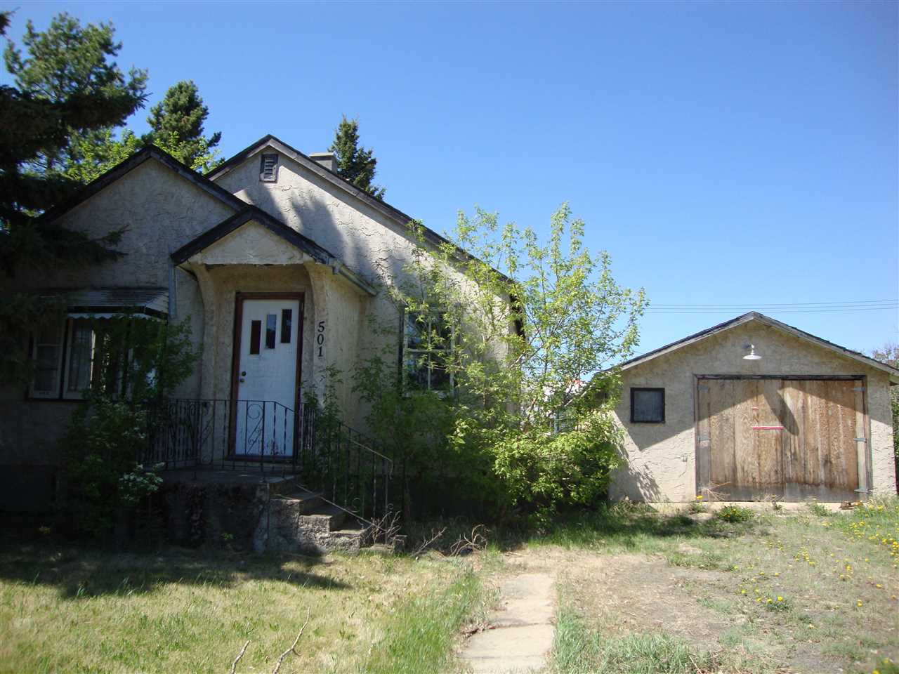 A property for the ambitious!!!  Potential value in the interior that could be salvageable (ie. trim, character windows, doors, hardwood floor). Foundation is not good. Garage is useable. Lot is huge -  50 x 125.