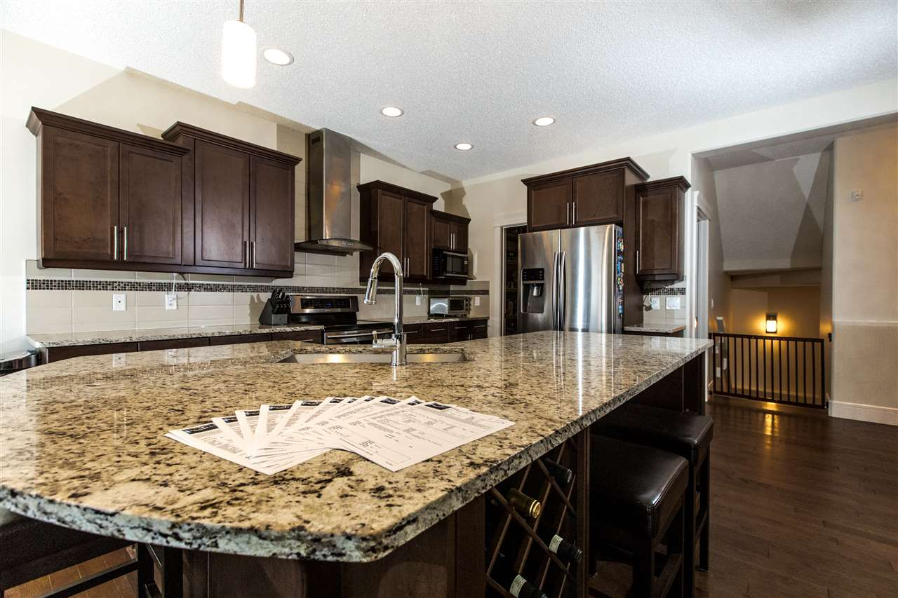 "STUNNING Sterling Built ""Triumph"" model home at 2336 sq ft. This SPACIOUS layout is PERFECT for the entire family. Kitchen is the Focal Point of the home with an oversized GRANITE ISLAND. Loads of countertop and cabinet space, stylish backsplash and high end stainless steel appliances! Other features include undermount sink with garburator, cabinet lighting and perfect dining space with access to the deck and backyard. GRANITE AND TILE UPGRADES THROUGHOUT THE HOME INCLUDE REAL WOOD HUNTER DOUGLAS BLINDS! Upstairs layout is AIRY  and  BRIGHT WITH A GRAND BONUS ROOM separating the master suite from the other 2 LARGE bedrooms. The master suite is FLAWLESS. 15X14  with large windows, beautiful bathroom with dual vanity. Walk-in closet, oversized 24x20 garage. TOP OF THE LINE Air Conditioner."