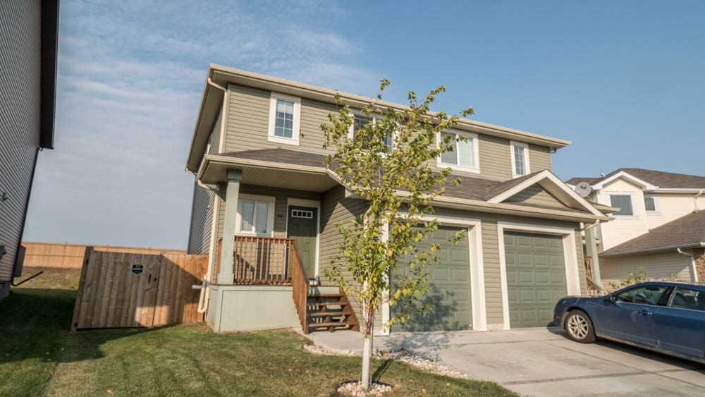 This gorgeous open concept half duplex in Leduc?s community of Tribute is so lovingly maintained that it shows as if it was still brand new, and it?s close to shopping, schools, and green spaces.  This lovely home features a spacious open plan main level, with lots of room in the kitchen and living room, a warm and inviting atmosphere emanating from the fireplace, and with a great view of the large, landscaped backyard from the dining area.  The upper level features two large master bedrooms, one with a four piece ensuite, and three piece ensuite for the other. Between the two is a conveniently located upstairs laundry with washer and dryer.  The unfinished basement is roughed in for a bathroom, and has room for you to convert space into a bedroom.  Central air conditioning will keep you cool all summer.