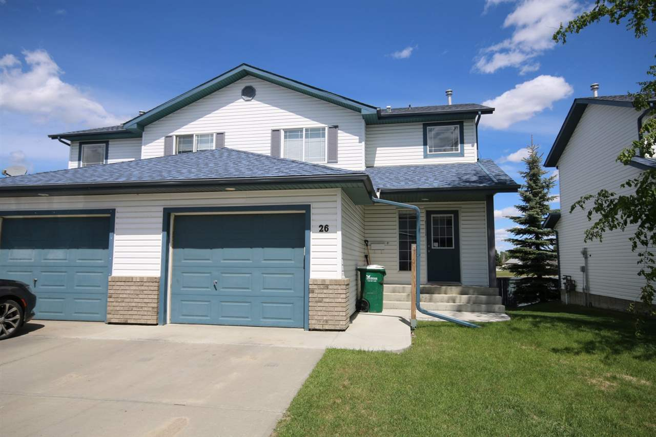 2004 fully finished 2-storey duplex in the Grove Meadows community of Spruce Grove.  Main floor offers a large front foyer, 2-piece powder room, eat-in kitchen with corner pantry & sliding doors to the 11x10 north-facing deck & a spacious living room. Benefits include a single attached, 20x12 garage & the location of being directly across from visitor parking.  Three bedrooms & a 4-piece bathroom complete the upstairs.  The fully finished WALK-OUT basement boasts a large family room w/ access to rear concrete patio, furnace room, flex/office room & a 3-piece bathroom.  Lovely neutral décor throughout complimented by white interior doors & trim. Located in the GROVE PARK condo complex, the condo fees are reasonable at $200/month & include lawn and snow removal. Fantastic access to schools, convenience stores, public transit & both Hwy 16 & 16A.