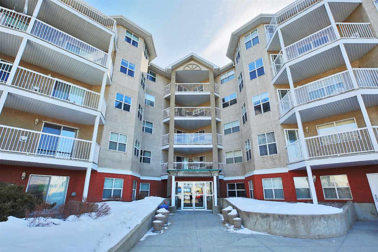 Situated perfectly across the street from Bonnie Doon mall, this lovely south-facing 1 bdrm unit (in age restricted 50+ building) is ready for you to move right in! This beautiful main floor unit is located just down the hall from the lobby in a quality adult complex and has been lovingly updated with modern laminate flooring. The suite features open-concept kitchen/dining/living room space with cozy, corner gas fireplace. The large kitchen overlooks the living area and has tile backsplash, double sinks, and lots of room for the kitchen table. Large master bedroom, 4-pc bath, and separate ENSUITE LAUNDRY room with lots of space for storage. Secure, heated, underground parking ? the parkade even has a car wash area! Excellent building amenities include a guest suite for visitors and a large social room (includes gas fireplace, kitchen, and a reading/TV/games area ... perfect for socializing!) Just steps to the bus stop, on a main bus route & FUTURE LRT - welcome to Melrose Court!