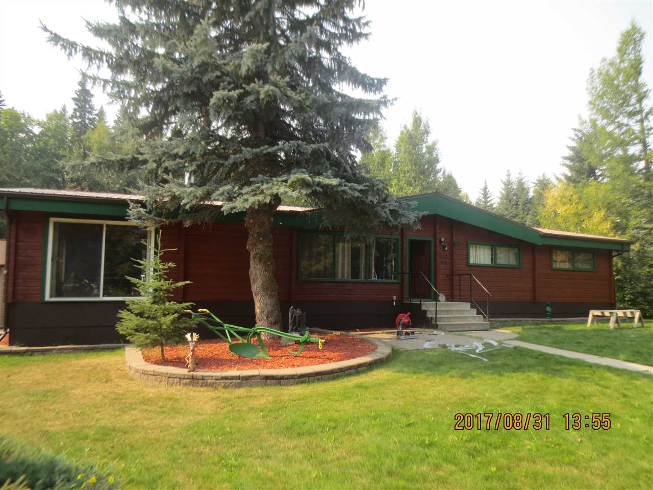 Below Appraised Value! 21.28 Acres in The Town of Edson! Country living, with Town Convenience! Beautiful 1840 sq. ft. Cedar log home on a very private acreage in Town Limits. Home features: 5 bedrooms, 3 bathrooms, living room with stone fireplace, lg family room, new kitchen with granite countertops, beautiful tile backsplash, new stainless steel appliances, upstairs laundry w/sink, & large windows. Basement includes 2 lg bedrooms, office, rec room, utility, storage, 3 pc bathroom & a huge wood stove. Quiet area, with a fully landscaped yard with mature trees, shrubs, garden area, flowerbeds, huge 2-tiered deck overlooking the b/yard, patio area, dbl/det garage with new siding & roof, cement floor & 220 wiring, 1148 sq. ft. Shop with dbl doors, cement floors, 220 wiring, fenced area & animal shelters & a paved driveway. Land is mostly bush with lg mature poplar, spruce, & pine trees. This property is designed for private acreage living with the option to run your own business with endless possibilities.