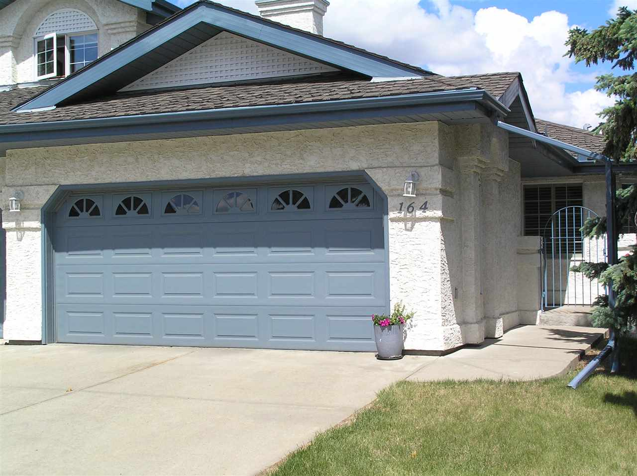 Gorgeous 2 plus 2 bedroom bungalow in sought after Whitemud Creek Estates, Phase 2. Adult (18yrs Plus) complex close to the ravine. This well cared for home has double attached garage, air conditioning and attached vacuum. On main floor is big master bedroom with hers 'n' his closets and adjoining door to main floor bathroom, another bedroom with glass paneled door. The bright kitchen has lots of cupboard space, plenty of worktops and breakfast nook. The massive bright living room with 9 feet cathedral ceilings opens up through new sliding doors to oversize deck (due to be repainted) with gas BBQ hookup in pet friendly fully fenced yard. The fully finished basement has just been refinished with new carpeted, baseboards and freshly painted. It has massive family room, 2 big bedrooms a full 3 piece bathroom and lots of storage. Electric chairlift is also included. This home is conveniently situated close to walking paths and the ravine  and is sure to please. It just feels good!