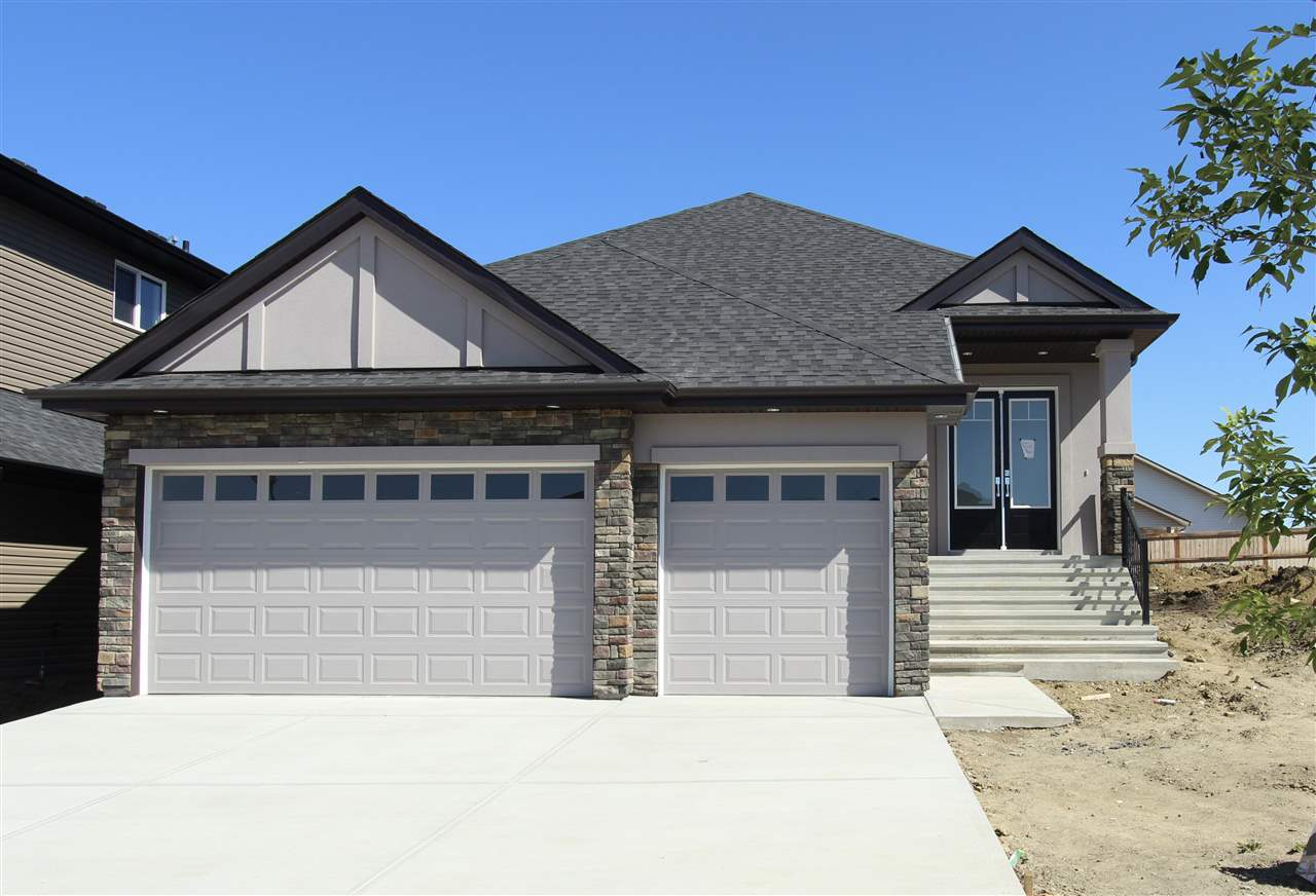 Exectutive 1700 sq ft bungalow with triple car garage located in the prestige area of Windrose.Step into the grand foyer and you will find a built in bench,ceramic tile floors and large front closet.Main floor open concept with hardwood flooring throughout.The kitchen is spacious with an abundance of cupboard and counter space, corian counter tops, SS appliances, pantry, adjoing dining area with French door that leads out to the rear concrete deck.Large bright living room area with electric fireplace.The master bedroom oasis features a French door to outside and consists of a walk in closet with built ins, large spa like ensuite with separate corner jacuzzi tub and glass surround and his and hers sinks.Completing the main floor is the den, 2nd bedroom with cheater door to main bath, and mud/laundry room area.The fully finished basement has a massive rec room area with built in wet bar, 2 other good size bedrooms, full bath and lots of space to have games/play/entertainment areas.This home shows a 10+++!