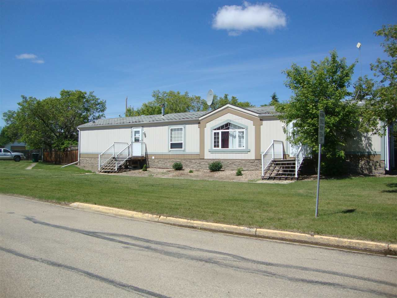 Very nice 1996 Winalta home with almost 1200 sq ft of living space, on HUGE fenced 99 x 220ft lot!! Double detached 24 x 24 insulated garage. Dog run. Storage shed.  Home is beautifully maintained and has CENTRAL AIR CONDITIONER! Kitchen boasts an abundance of modern white cabinets, lots of counter space and opens to a good sized lvg rm. Mstr bedrm features huge walk-in closet & a full 4pc ensuite. 2 addt'l bedrms & 4pc bath complete this home. The exceptionally big backyard is wonderfully quiet, serene and comfortable with privacy trees along property line and high fencing. Excellent central location within walking distance to all amenities.