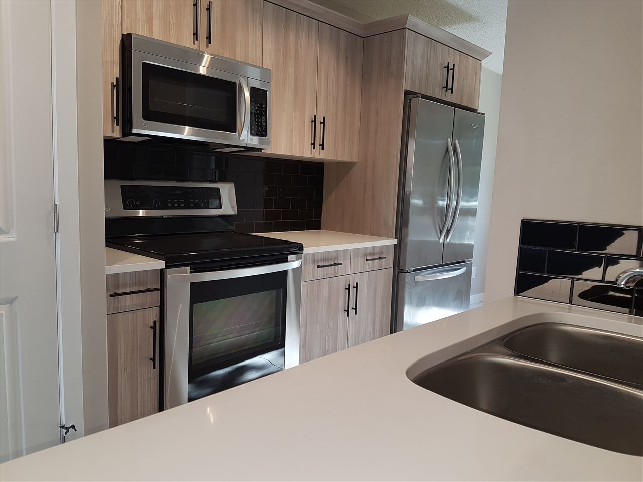 Incredible completely renovated townhouse in the perfect location.  Steps from Broadmoor lake (and Broadmoor lake park) or the Sherwood park mall, right down from the golf course or the Kinsmen leisure center.  Backing out onto a green space with soccer fields and schools just down the road. An amazing combination of quiet and peaceful mixed with convenience and proximity.  Not only is the location amazing but it has just as much if not more to offer inside! This townhouse has been completely redone.  New tile and carpet floors, high end kitchen and bathroom finishing (even quartz counter-tops) as well as the details from the custom built in cabinets to the high end light fixtures, this home is ready to move in and enjoy.
