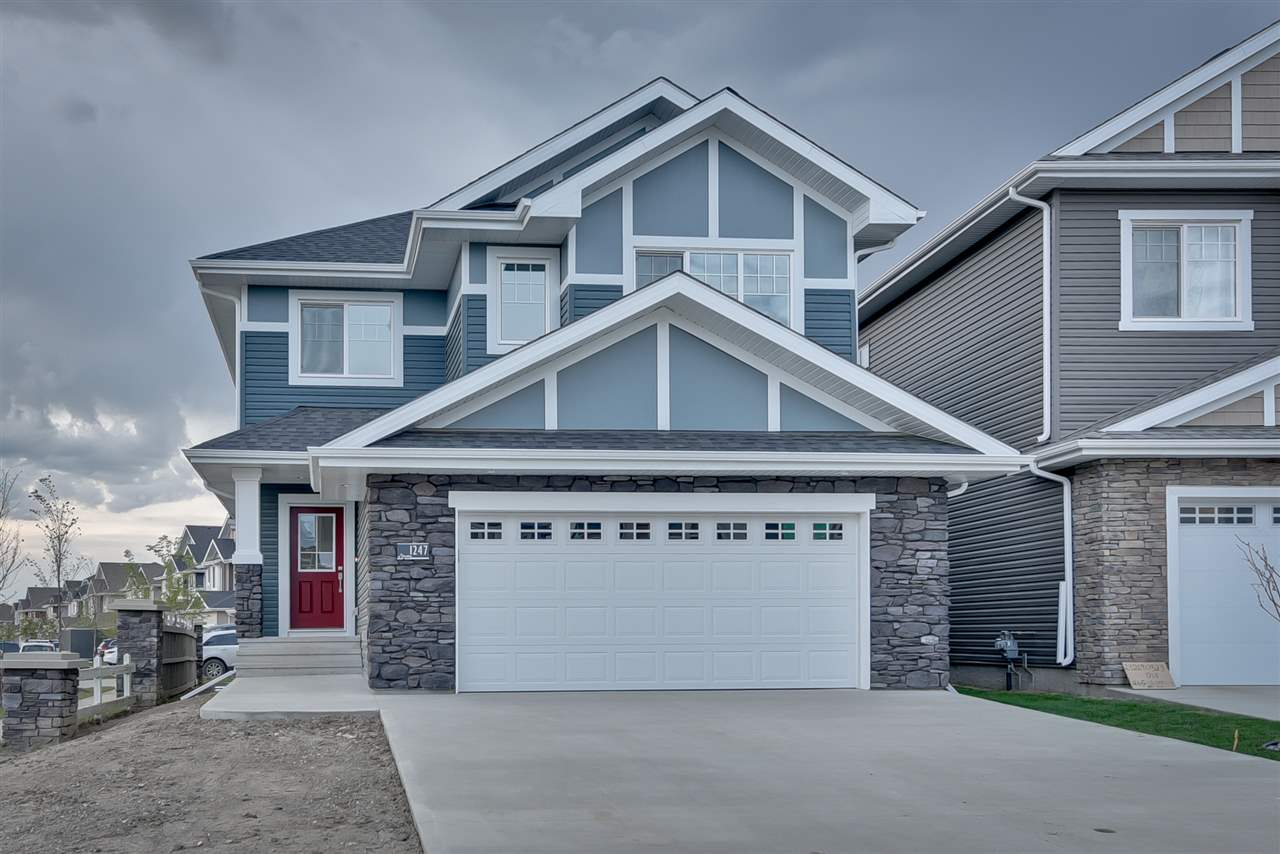 Welcome to this award winning New Castle 1 model by BLACKSTONE HOMES. This model has won best house in AB in year 2016 & 17. Upon entry you will be welcome by nice big foyer which leads you to great room with 18 ft. high ceiling with stone work finished off with beautiful coffered ceilings. Chef's dream white maple up to the ceiling kitchen with lots of cabinets, huge island, built in appliances, spice rack. A must on everyone's list, mud room with bench shoe racks & built ins. Main floor den & laundry with sink completes the main floor. Beautiful glass railing & lights in stairs will lead you to the 2nd floor. Upstairs you will find 3 bedrooms, 2 baths & bonus room. Huge Master bedroom with beautiful ensutie and huge walk in closet. Master bath has Jacuzzi, double sink and tiled shower. Other Features - Quartz throughout, MDF Shelving, Deck, Window Coverings, Built in appliances, Lights in stairs, soft closing cabinets throughout, Upgraded flooring, pot lights in open area, New Home Warranty & much more