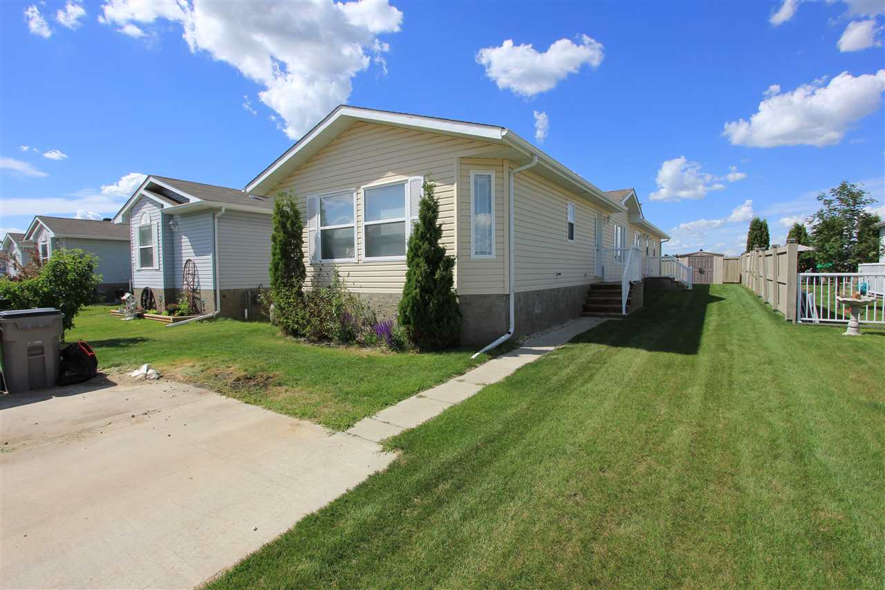 What an amazing affordable home on it's own lot in a convenient location in Stony Plain! Easy access to major commutes, close to hospital and shopping, but still only 15 min west of Edmonton! This modular bungalow home offers over 1,500 sq ft of space with functional layout, large living room and dining area, spacious kitchen with plenty of counter space and pantry, large master bedroom with walk in closet and 4 pc ensuite, two more generous bedrooms and 4 pc bath and a BONUS ROOM! Yes, a bonus room that could be used as an office, or play room or even a bedroom! This home is full of natural light and large windows, well maintained and has a parking pad for two cars as well as a shed at the back!