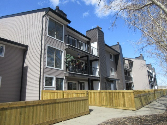 Welcome to Meadow Mews! This main floor 1 bedroom, 1 bathroom unit has a nice cozy wood burning fireplace, laminate floors throughout, and a fenced in yard. It over looksa  nice greenspace with a park and is located close to Anthony Henday and for great commutes. The condo complex has had a complete renovation with new siding, windows, balconies, fences, and common areas.