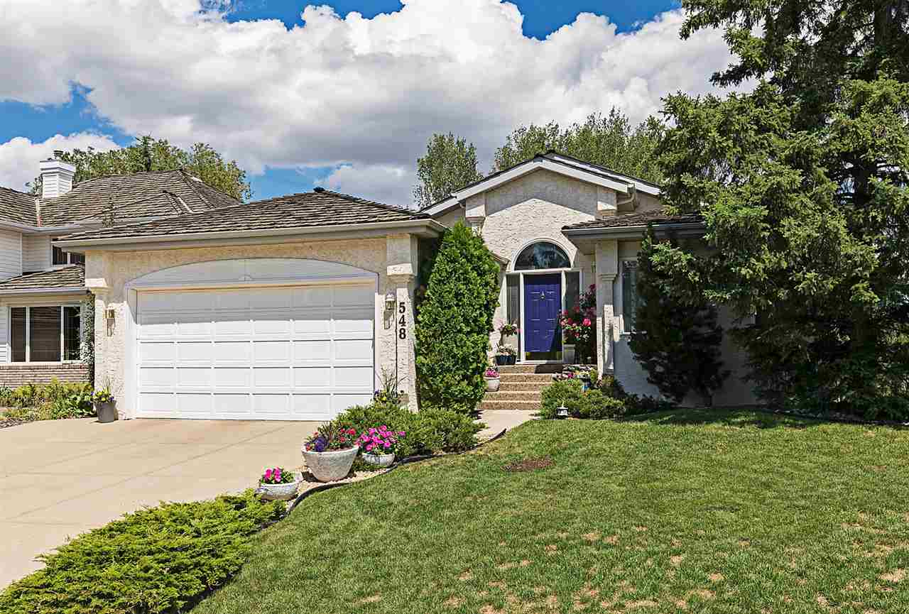 What an opportunity to be part of this sought-after community in Oleskiw & Country Club - just steps from the Edmonton Golf & Country Club & walking paths where you can enjoy the River! This massive 1,861 SqFt bungalow has been lovingly cared for & pride of ownership is throughout. The open-style layout & 6 total bedrooms is perfect for any family who loves to entertain their family & friends. The main floor has vaulted ceilings w. decorative crown molding, large windows (some new in 2017) & an open staircase (featuring a live tree & rock garden!) to the Fully Finished Basement that has convenient access to the attached double garage. The kitchen boasts hardwood, plenty of white cabinets & counterspace & is open to the sunken family rm. There is a separate living rm, spacious dining rm & laundry rm. The 2 Bedrooms up incl. a huge master bedroom c/w a full ensuite. The bsmt has 4 bedrooms; a massive rec rm, full bath & flex rm. The newer deck leads to your private & treed oasis of a yard to call your own