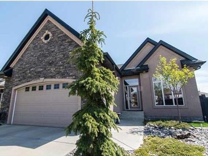 Beautiful Custom-Built Burke Perry Executive Walkout Bungalow! As you enter this home you are greeted with 10ft ceilings, an open floor plan, an outstanding stone fireplace and multiple large windows. The main floor also features a large master with ensuite, a second bedroom, main bath, office with a large window, formal dining area as well as an open kitchen living area. The basement includes 9ft ceilings, a wet bar with full-size fridge, open recreation and living area, a full bath, exercise room, laundry as well as 2 additional bedrooms, one of which includes a walk-in closet. Quality construction includes R50 Attic Insulation, Soundproofing between master and living room. Both levels of this home include amazing patios to enjoy the sun in the afternoon and the city lights in the evening. This home is located within a quiet crescent on a pie lot within walking distance to schools, public transit, and walking trails.  If you didn?t already love this property we are offering 6 months of lawn maintenance!