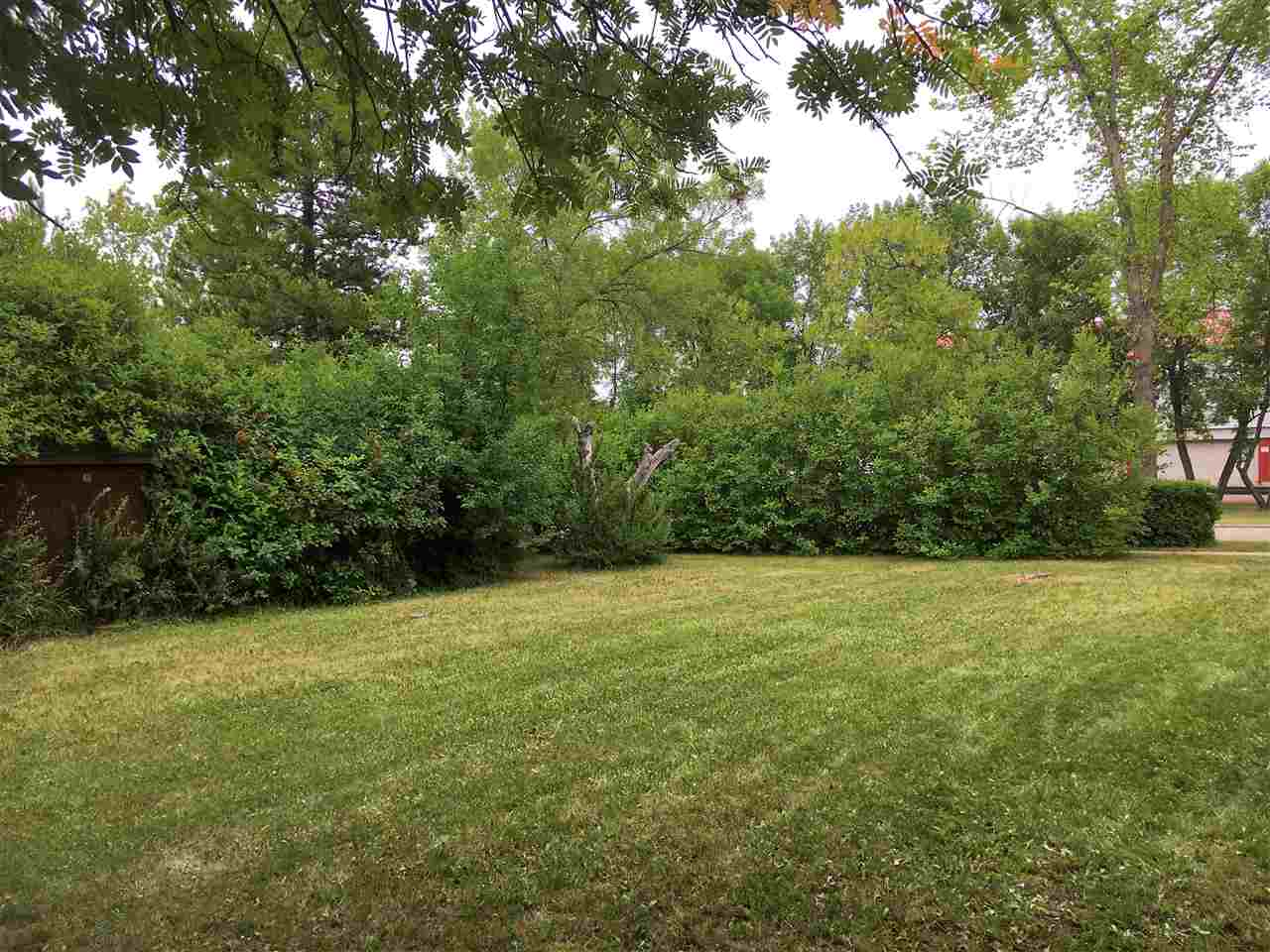 Approximately 46x113' lot in mature neighborhood across from the Community Centre and Arena. Approved for duplex. Zoned R2