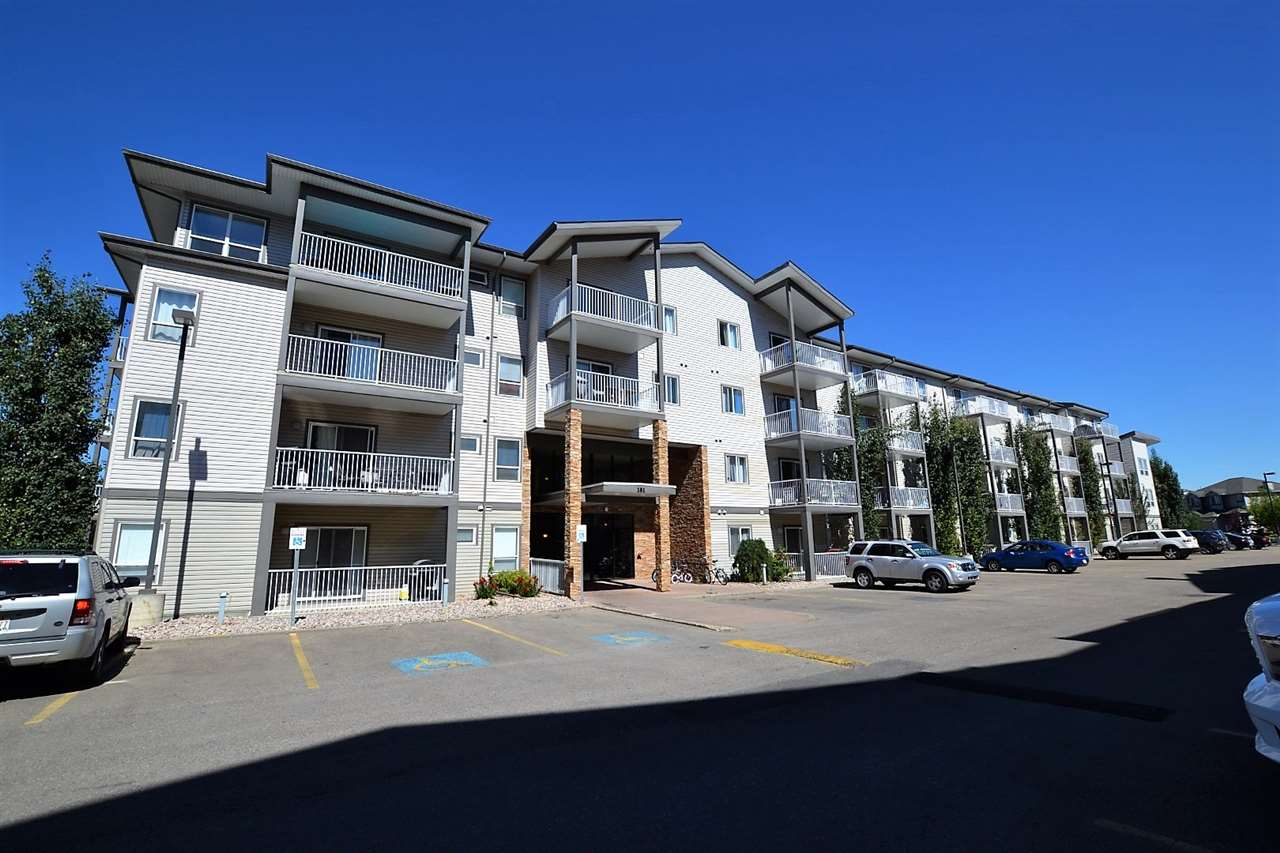 This ground-floor unit offers EASY ACCESS, GREAT LOCATION, and 2 TITLED PARKING STALLS! With 828 sq. ft. of space, it has 2 bedrooms, 2 bathrooms, a spacious kitchen complete with white appliances, and a nook with room for a dining set. The kitchen opens to the bright living room, which offers access to the railed balcony. The master bedroom offers plenty of space for your bedroom set, and the large walk-through closet leads to your own private 4 piece en-suite. The second bedroom sits across the suite, on the other side of the living room. There is another 4-piece bath with in-suite laundry, and a storage room with plenty of space. The building has an exercise/fitness room and is close to the South Edmonton Common (for all your shopping needs), schools, and numerous restaurants and other amenities. This unit really does offer a complete package for those looking for convenience at an affordable price. Come see it today!