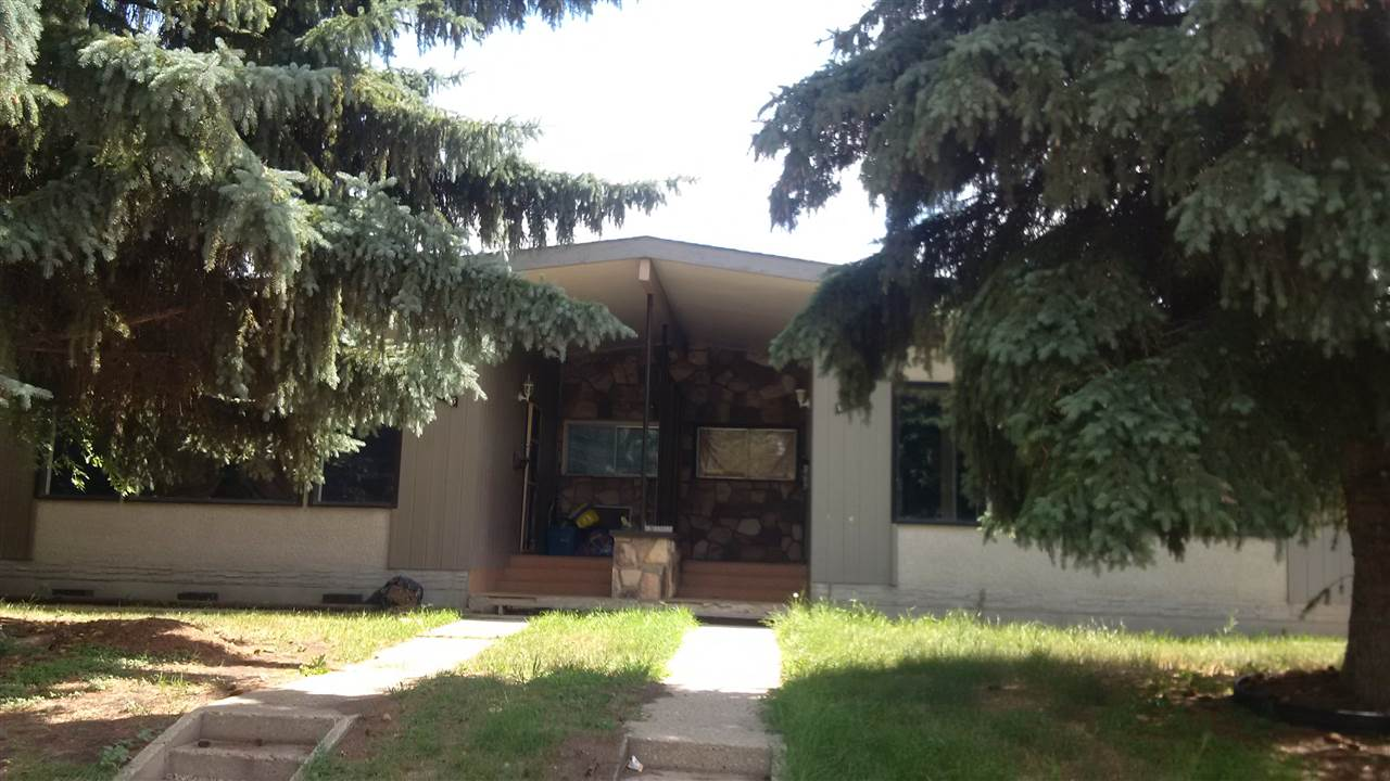 Investment - Revenue property - Spacious and well designed side by side duplex nicely located and on a huge 8,177 sq ft, lot - great access, with 3 BR unit and 4 pce bath per side plus fully finished basement levels. Single detached garages. Needs TLC and improvements - great potential.