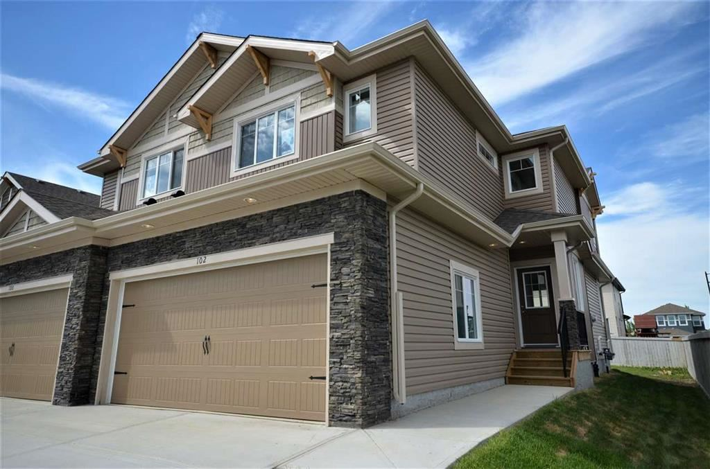 Brand New Duplex located in the Growing McLaughlin Community! Great Location to Tri Leisure Center, restaurants, & Shopping. Large Corner lot with Dbl Car Garage (25.5 ft L x 18 ft W) can fit the Truck, Driveway is 33 ft Long. Front Landscape and  8' x 10' Deck in Backyard Included. Main Floor Boasts 9 Ft Ceilings, Ceramic Tile & Laminate Flooring. White Cabinets & Quartz Counters in Kitchen And Bathrooms. Roomy Foyer w/Coat Closet, Access to Garage and 2 PC Powder Room. Spacious Master w/Walk-In Closet and 3 PC Ensuite Located Upstairs. There are 2 More Bedrooms and a 4 PC Bath Completing the Upper Level. Unfinished Basement with 9 Ft Ceilings and Strategically placed Roughed in Plumbing for Future Bath. Neighborhood Playground and Walking Trails across the Street.