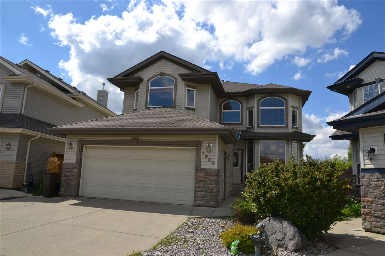 This exceptional, open 2 Storey is located in prestigious Hodgson of Whitemud Ridge & steps to Hodgson park/playground. This home boasts 2480+ sq ft, 3 upstairs bdrms w/ walk in closets, 2.5 bathrooms plus a 5 piece ensuite with double sinks & jacuzzi tub, large den/office & incredibly spacious bonus room w/ vaulted ceilings overlooking LR/DR. Kitchen w/ island/raised bar, corner pantry, large eating nook, stainless steel appliances including gas stove for better cooking is open to the family room with gas fireplace. Patio doors off of the kitchen opens to the lovely, west facing deck and massive pie shaped backyard that is fully landscaped offering your own private oasis. Maple hardwood floors in the LR,DR, KIT & FR, slate front entry, main floor laundry, beautiful maple & pewter railings throughout, soaring high ceilings & windows from floor to ceiling in the living room make this home bright throughout. Easy access to public transit, shopping, Derrick Club & Terwillegar Rec Centre.
