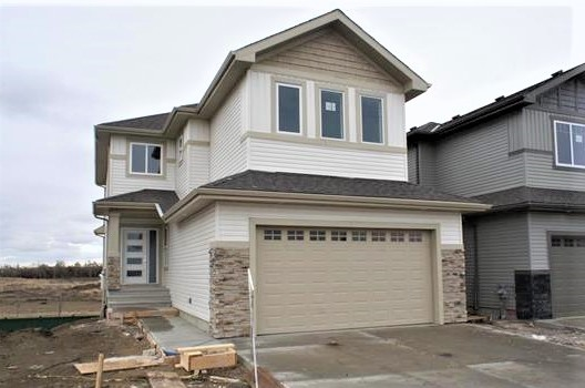 The Lakeview Two by Super Homes. 2081 square foot two storey. Very open bright and cheery, modern floor plan. Main floor features great room with gas fireplace and 17? high stone floor to ceiling gas fireplace with entertainment center. Large eat in kitchen with functional island and walk through pantry to main floor laundry / mudroom. Main floor two piece bath. Main floor office, dining room or children's day time playing area. Bright open foyer leads to upper level open to below bonus room and three large bedrooms. Master bedroom has large walk in closet and five piece ensuite with corner jet tub. All kitchen and baths have granite counter tops and there is a very generous amount of ceramic tile and hard wood flooring. Rear deck is included. Walkout basement Oversized 21.6'/23.6'/ 27' deep double garage. Located across from park. Excellent Location no houses behind you.  For Additional Information visit the Super Homes showhome @ 5 Wallace pointe, Fort Saskatchewan