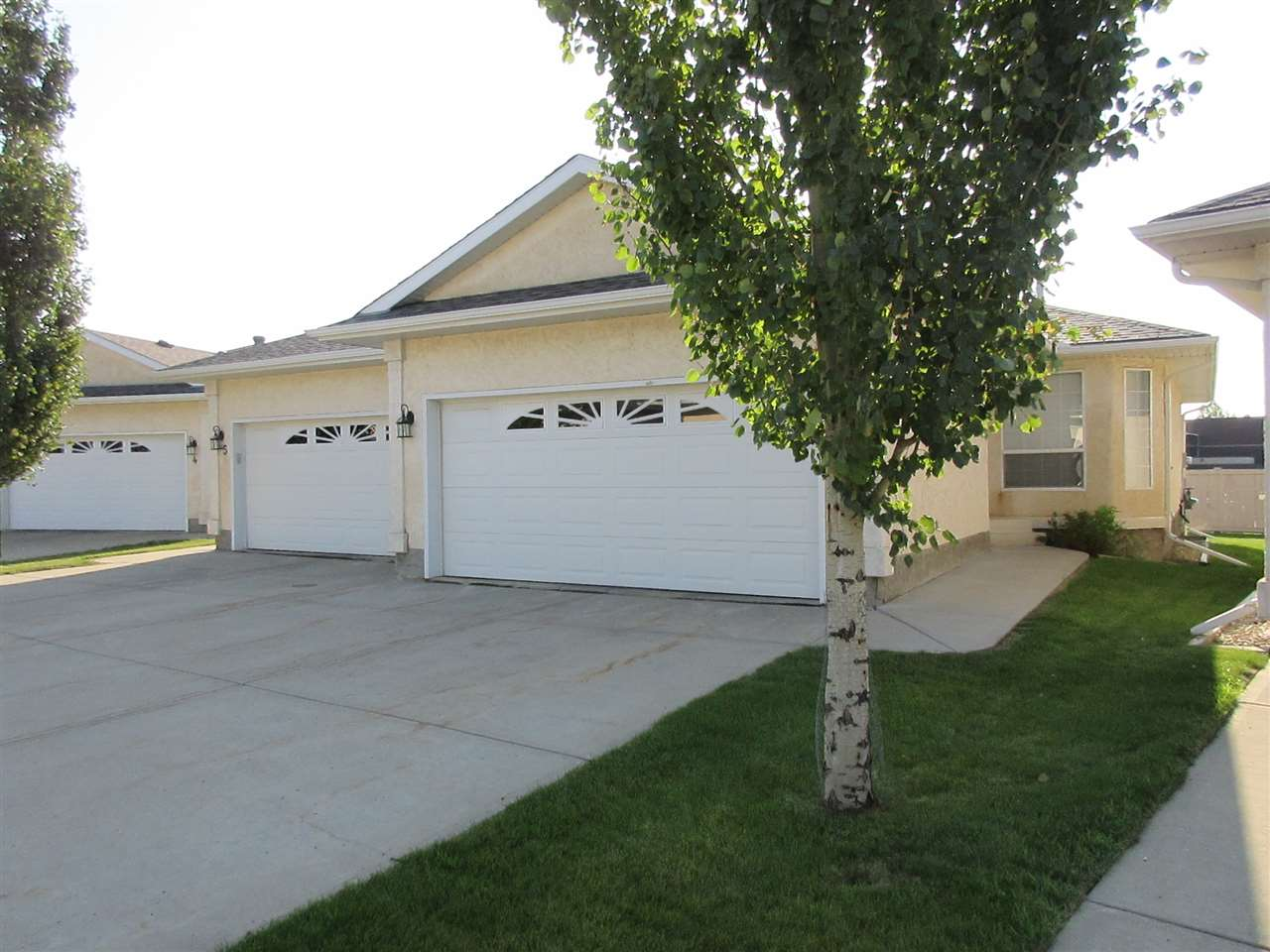 Immaculate - Adult - 45+ 1/2 Duplex - Miller Garden Estates - Double Attached Garage with Inside Entry and Main Floor Laundry. Large Kitchen open to Dining and Living Rooms. Master Bedroom features Walk-in-Closet and 3 Piece Ensuite. 2nd Bedroom and 4 piece Bath off Hallway. Garden Door to Deck off Living Room. Open Basement for Future Development. Shelving in Basement, Stair Climber and Ramp in Garage stay. Good location in Complex.