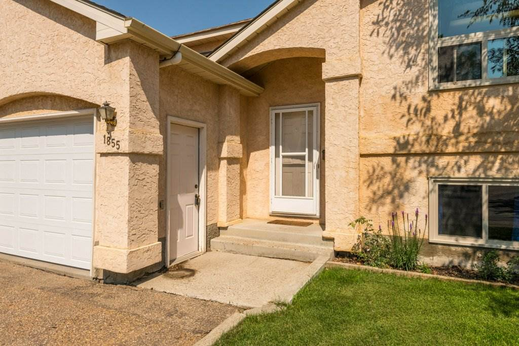 Tremendous VALUE!!  This Large, Bright, Private, Move-in-ready bi-level townhome offers over 1300 sq ft of finished living space in Daly Grove.  NEW HE FURNACE & WINDOWS Spring 2018.  Neutral colours throughout this home that has an open floor plan with spacious living room with gas fireplace. A few steps up from the living room is the open style loft a great spot for a home office. Dining room has lots of natural light, with patio doors that lead to balcony perfect for barbecuing. The kitchen has plenty of storage and counter space and features stainless steel appliances including gas stove. Downstairs offers two large bedrooms and 4-PC bathroom with granite counters and tile surround tub. The master has a huge walk in closet and lots of extra storage under the stairs. Single attached garage, prime location in the complex, Tennis court on site, Close to all amenities - what's not to love?