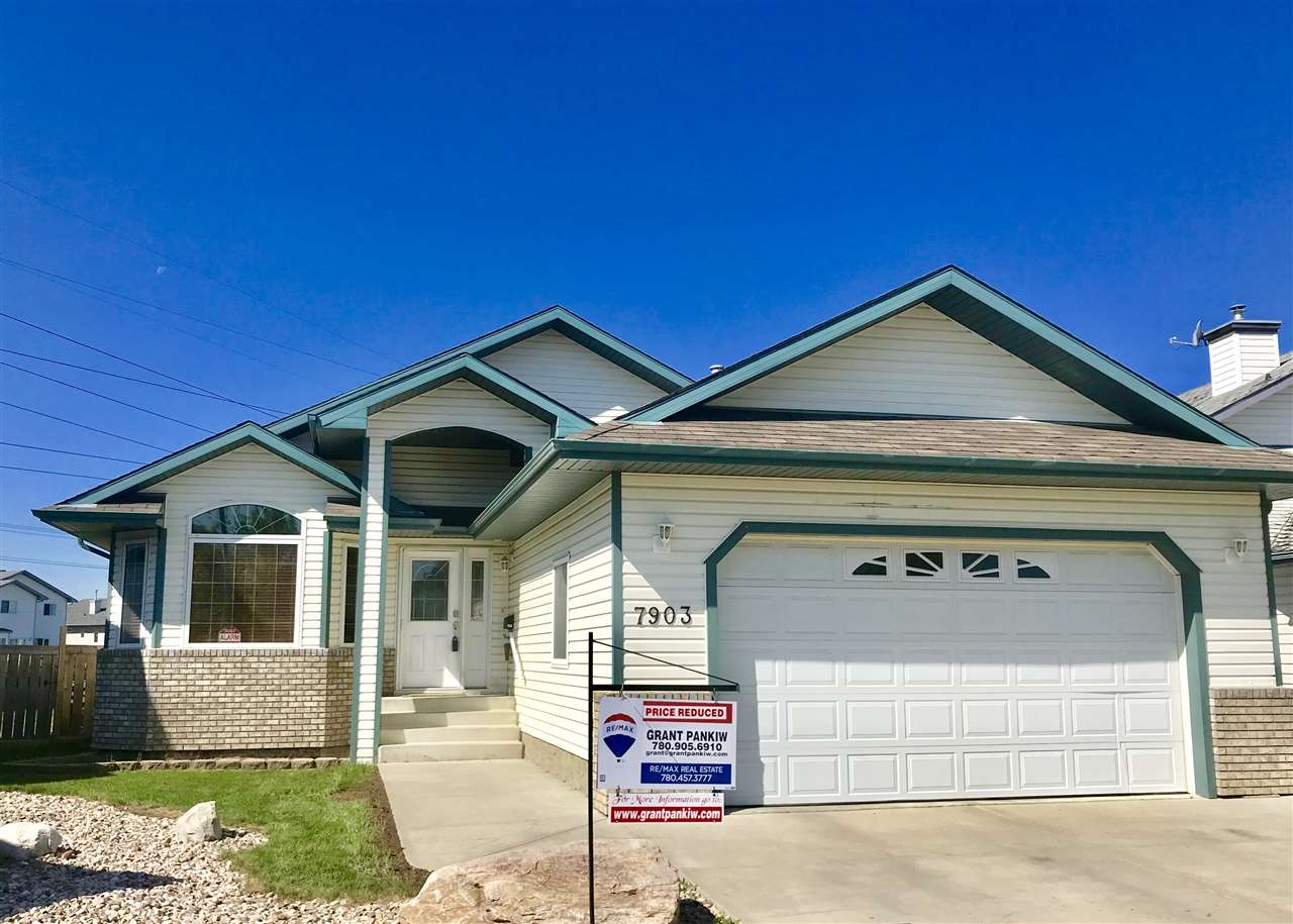 Beautiful vaulted ceilings on the main floor of this 1469 sqft bungalow with hardwood floors in the living room and den.  Located in a mini-crescent location and on a large south-facing, pie-shaped lot, backing onto a walking trail, this 2 bedroom plus den home has central air-conditioning and a developed basement with 2 extra bedrooms, a family room and a 4-pce. bathroom.  The master bedroom has a walk-in closet and 4-piece ensuite bathroom with a jetted tub, the kitchen has a walk-in pantry and stainless steel appliances, there is a central vacuum system, and there is a deck with a gas line for a bar-be-que.