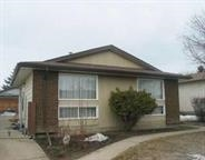 Awesome 4 split with parquet hardwood in the living room and dining room and ceramic flooring in kitchen and bathrooms. Features a large yard with double garage. Close to shopping, schools and public transportation.