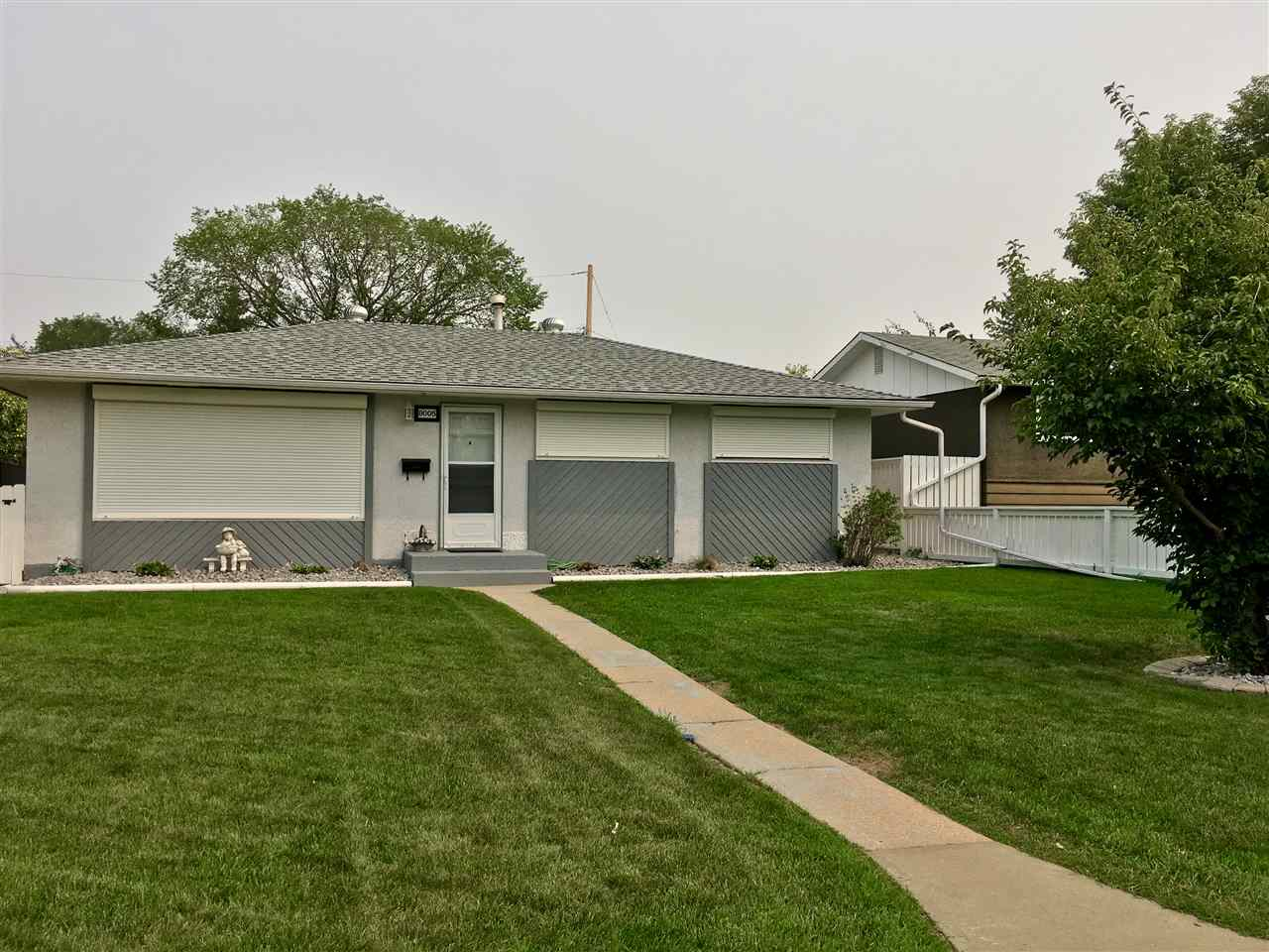 STRESS TEST BLUES got you down? Turn your frown upside down, this CUTE AS A BUTTON bsmt less bungalow in Elmwood makes SINGLE FAMILY home OWNERSHIP possible! No need for a duplex/townhouse! With 1055 sq ft, 3 bedrooms, SPACIOUS yard, and DOUBLE GARAGE, you will LOVE living here! The yard is a GORGEOUS OASIS with so much new landscaping and fencing done! Don't forget the shingles, garage doors, eaves/soffit, vinyl deck, roll shutters and ext. painting too! PRIDE OF OWNERSHIP is evident! Inside is full of character with AWESOME 1? hard wood floors, oak feature walls, a great kitchen, and tons of storage in the crawl space so you can easily park 2 vehicles in your insulated 22 x 24 garage, that also includes 220 power! With a SUPER CONVENIENT location, QUICK ACCESS to the Whitemud, Henday, West Ed, Meadowlark Mall, Schools ad playgrounds, you can meet all of your needs easily! Come take a peek and snag this GEM before it's gone! It's a great opportunity to move in and add your personal touches to the rest!