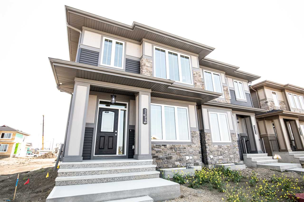 TURN KEY LUXURY DUPLEX IN PRESTIGIOUS SW COMMUNITY. Built by 7 time builder of the year Kimberley Homes, this duplex has it all! Fully landscaped, high end finishings, smart layout, private yard, the list goes on and on. The main floor is open concept with a spacious U-shaped kitchen c/w stainless steel appliances, high end cabinetry, under cabinet lighting, stone countertops throughout and large pantry, that opens onto the bright living space with tons of windows. A generous eating area completes the entertaining space. There is also a den on the main floor, a mudroom with built ins and a 1/2 bath. The king size master has a large walk in closet and gorgeous 5 piece ensuite. Upstairs also has 2 additional bedrooms, BONUS ROOM, LAUNDRY and main bath. Located in Keswick on the River with walking trails and river valley just steps away, shopping and all main travel arteries within close proximity. Landscaping to be completed by builder.