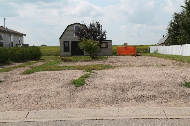 Mobile home lot ready for you to move your new home onto. The lot is serviced so all you need to do is move on and hook up to the already in place services. There is also a large two story shed with a lean to on the property.