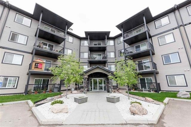 HUDSON CONDOMINIUMS Your new 2 BEDROOM, 2 BATHROOM, 2 PARKING STALLS MODERN CONDO AWAITS YOU. This unit features a very spacious and open floor plan with bedrooms on separate ends of the unit, both with their own bathroom close by. This unit features DARK MODERN cabinetry, black appliances, glass tile back splash, Shag carpets, and tile in both baths. Spacious master bedroom with walk-thru closet and 4 piece en-suite bath. Spacious balcony offers expansive unobstructed views from the 3rd floor and natural gas BBQ hook-up as well. 2 PARKING STALL INCLUDED, 1 UNDERGROUND/HEATED STALL AND 1 OUTDOOR STALL PERFECT FOR SECOND VEHICLE.Building features IN-SUITE LAUNDRY, great neighbourhood, and very well fitted FITNESS FACILITY and PARTY/GAMES ROOM. Located near shopping, transportation and all other amenities. MUST BE SEEN