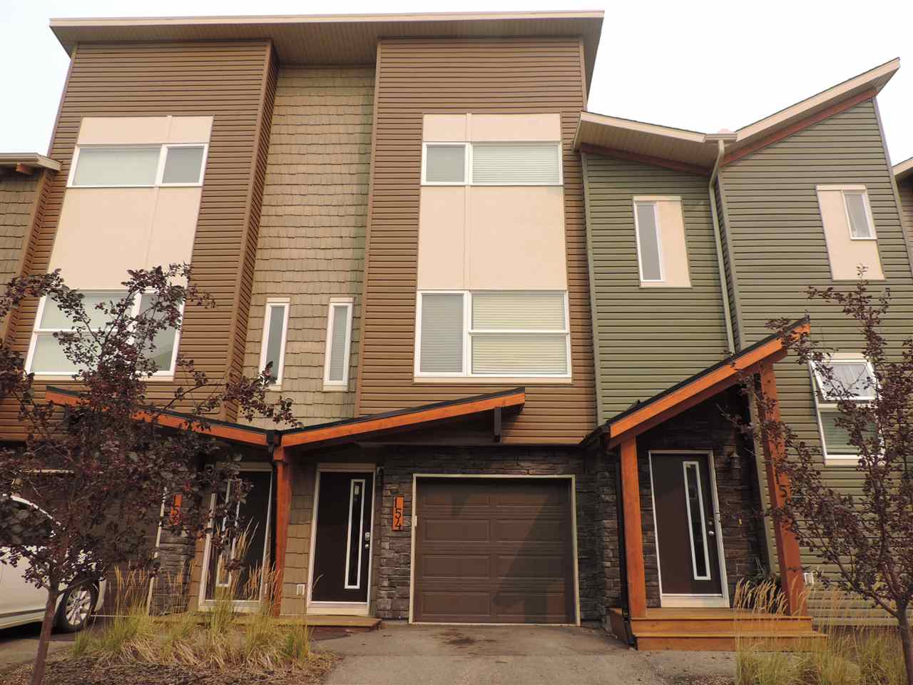 This 2 storey condo is 985 sq. ft. with front attached single garage. The main floor is an open concept with large kitchen with lots of cupboards and counter space. The counters are granite and a brand new fridge has been installed. This level has lots of windows that bring in loads of natural light to the dinning area and living room. there is also a large closet and access to the deck. The upper level has 2 bedroom and 2 bathrooms, walk in closets and upstairs laundry. The singles attached garage has ample storage space as well.      The door code is 1943