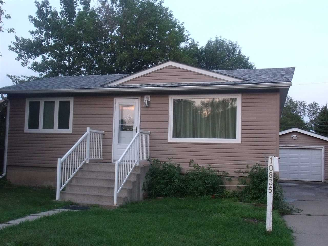 """Come see this cozy 2+2 bedroom, 2 bathroom bungalow on a huge lot in the mature West End neighbourhood of High Park, completely professionally upgraded & move-in ready. Quality upgrades include new shingles (2017), siding on house & garage w/2"""" styrofoam insulation on house, South foundation waterproofed (2017/18), wiring upgraded to 100 amp service, triple glazed windows throughout, new bathrooms up & down, kitchen & bathroom cabinets & countertops replaced, newer flooring on main, brand new flooring in basement, newer furnace & hot water tank, newer overhead garage door & all exterior doors, plus more!  Enjoy the large 50' X 118' fenced yard w/ample room for RV parking. Home is conveniently located close to schools, shopping, transportation, recreation. Minutes to Yellowhead & Whitemud freeways & West Edmonton Mall. Welcome home - just unpack and enjoy!"""
