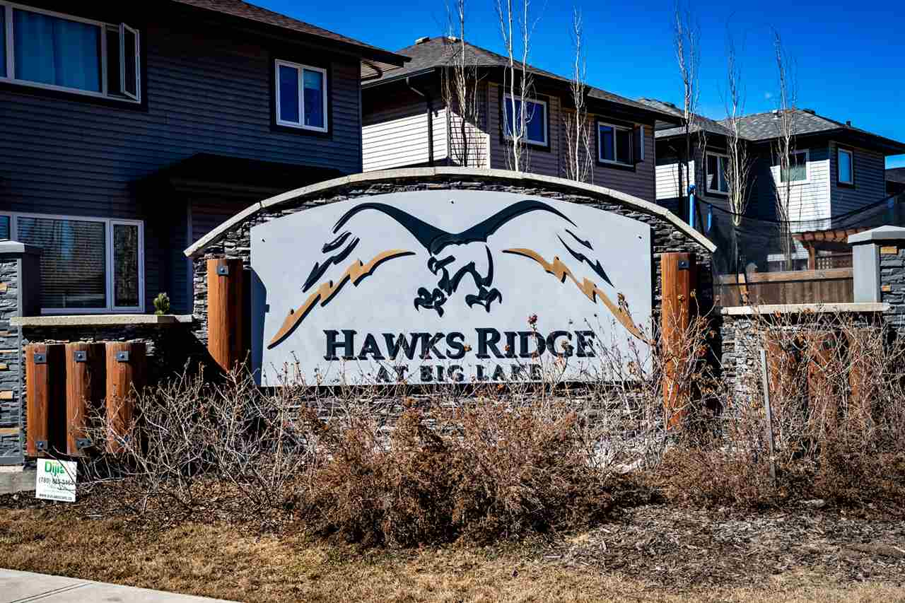 Welcome to Hawks Ridge at Big Lake. Life in Hawks Ridge is the perfect blend of convenience, comfort, sustainability and beauty. The community is surrounded by open, natural space. Bringing together timeless style and classic home design, you'll love this charmingly crafted apprx. 2119 square foot 2 storey. This stunning open-concept home that features 9' ceilings on every floor, upgraded quartz counters, and a double attached garage. Your main floor has an inviting front entry, a large den/office, a walk-through pantry from the mud/laundry room that leads to the kitchen where beautiful cabinets and an abundance of counter space make a perfect place to host friends and family. With its open floor plan, you can see everything going on in your spacious great room where a fireplace makes a stunning focal point. Head upstairs and enjoy some R&R in any of three large bedrooms, including a master sanctuary with a walk-in closet and 5pc en-suite or cozy up with the family in your large bonus room!