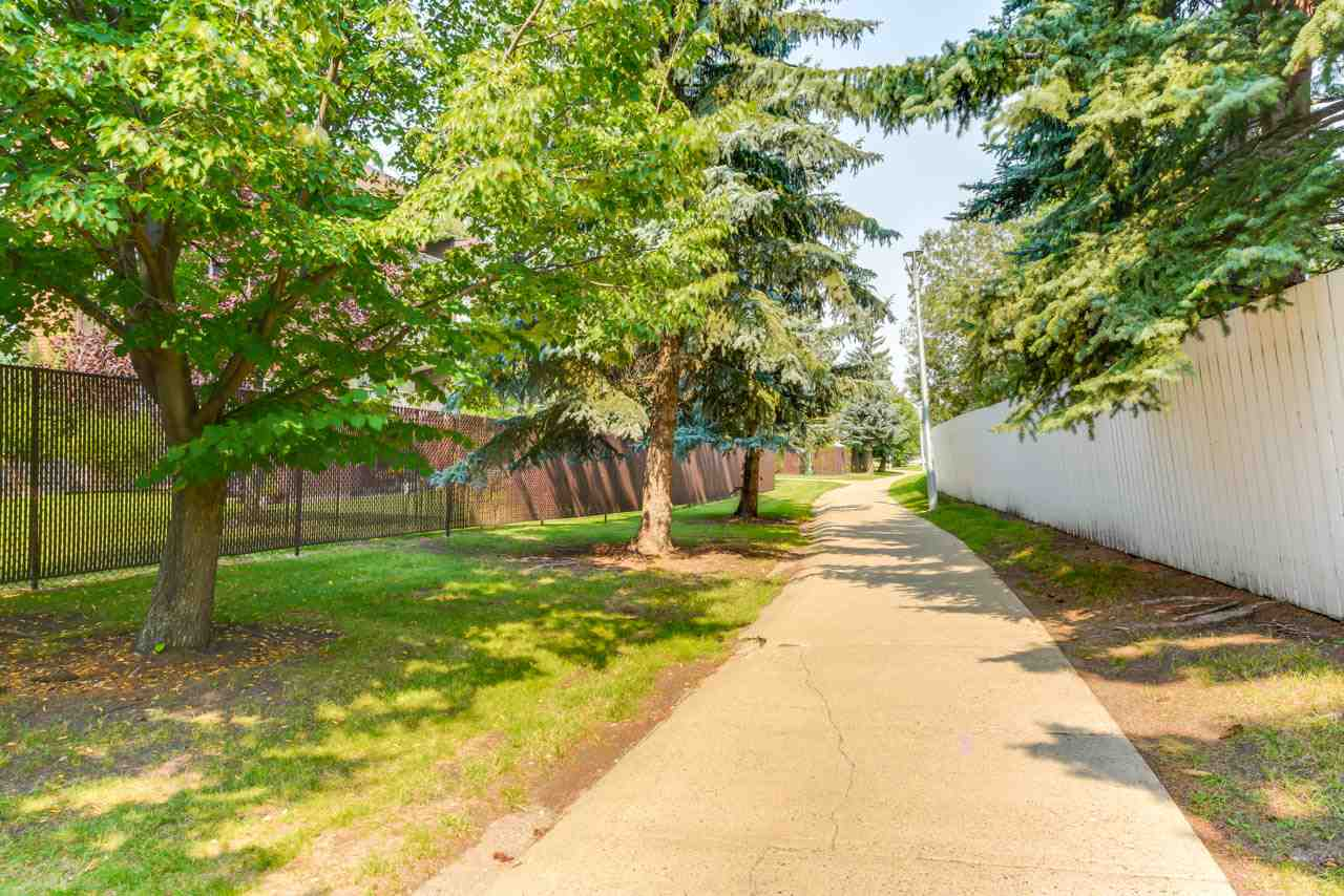 Expect to be impressed! Country Gardens in Edmonton's Riverbend area is a 40+ age restricted building hosts large floor plans, amazing amenities, single monthly payments for all utilities, phone, cable, internet & property fees. This 1800 SqFt floor plan provides space to downsize from a large house without having sacrifice your current lifestyle & home furnishings. This 2 Bed + Den 2 Bath condo boasts an open concept main living room & dinning room. The dinning room allows for a full size dinning room table, china cabinet & buffet, Ideal for having large family gatherings. The kitchen is delightfully updated with granite countertops, cabinetry & appliances. The guest bedroom is a great size & can easily accommodate a full bedroom set. The master bedroom allows for a full bed set plus room for a seating area & has a 5 piece en-suite and walk in closet. The den is ideal for a home office.  2 underground parking stalls, A/C, indoor pool are just some additional features.