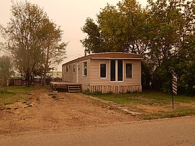 2 bedroom mobile home located on an owned lot in Coronation, AB. This property has had the following reno's, drywall, windows, flooring, trim, doors, bathroom vanity, deck and rear steps. This property really has had a number of great improvements made. This property is going to make and great 1st home, retirement or revenue property.