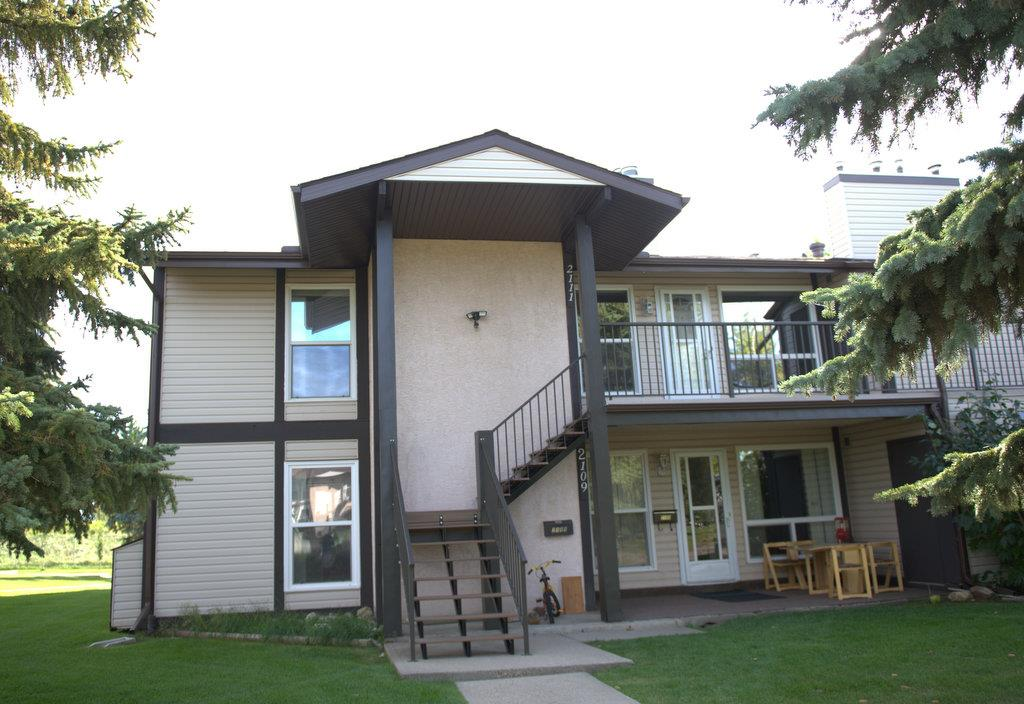 Across the street from Blackmud Ravine hiking/biking trails, this freshly painted top floor end unit has extra windows for lots of light. Owner may convert den into 3rd bdrm. Large north facing main bdrm & 2nd bdrm both have walk-in closet. Catch the evening sun with the large maintenance free west facing deck with storage shed. The kitchen features a large walk-in pantry & opens to the generous sized dining/living rm with cozy 2 sided wood burning fireplace. Easy access washer & dryer in this no smoking/no animal home. This quiet professionally managed pet friendly complex has recently replaced the roofs, stairs, siding, railings and windows & is a short walk/drive to Century Park LRT, YMCA, schools, shopping & playgrounds. Unit has easy access to a green space for your kids to play & the parking stall is on end directly in front of the unit. The condo fees include snow removal from your deck and steps, exterior maintenance & landscape. The carpets have been recently professionally cleaned.