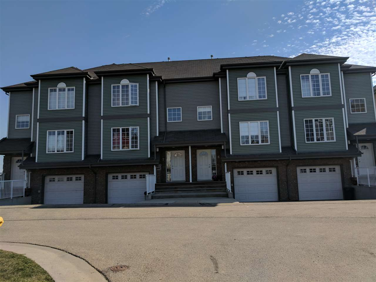 Family sized 3 bed condo w/ 3 bathrooms. Big ensuite, second floor laundry, eat in kitchen & dining room, lots of storage , low condo fees, tandem garage for 2 & storage area. Heated gar & pad. Lots of visitor parking, well managed.