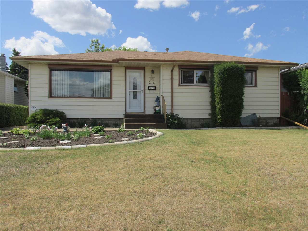 Beautiful interior & well taken care of upgraded 4 bedroom, 2 full bath, bungalow with over 2000 sq. ft. of living space. This spotless home features all and NEW TRIPLE PANE WINDOWS, NEW EXTERIOR DOORS, including roll shutters on all main floor windows. UPGRADED KITCHEN cabinets with CORIAN COUNTERS , spacious dining area & a gorgeous picture view of your lovely landscaped yard .Spacious living room with plenty of sunshine & picture window! Hardwood, laminate and ceramic flooring throughout. Your sure to be pleased that your Master bedroom will accommodate a King size bed! Finishing your main level are 2 more bedrooms & a 4 piece bathroom. The basement is fully finished with a large family room, fireplace, 4th bedroom, & an additional 3 piece bathroom. The yard is huge and beautifully landscaped with a lovely 2 tier deck, gasline hook-up for a BBQ or heater, shed, mature trees, garden, a sunny west facing & a double detached garage. Minutes from shopping, schools and amenities. Welcome Home!!