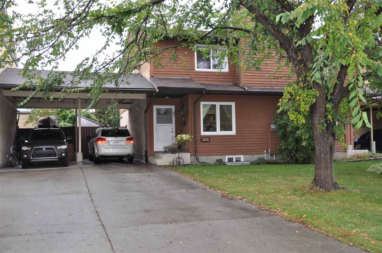 """Cedar Crescent is a small (24 units) half duplex style self managed townhouse complex. The units are located in their own quiet cul-de-sac close to all amenities. A short walk (10-15 min) to the LRT station.  Also close by you will find  shopping, restaurants, medi-centre, banks, playground, black mud ravine & schools. Unit 2212 is a 1151 SqFt 2 story home. It has 3 bedrooms upstairs plus the main 4pce bath. On the main floor is the living room with wood burning fireplace, a large eat-in kitchen with a movable island and patio doors to the back deck plus a 2pce powder room. In the finished basement is a nice sized family room, a 3pce bathroom and a den. The den is currently being used as a storage room. Upgrades within the past 4 years include a high efficient furnace, hot water tank, kitchen appliances, flooring, paint, deck and landscaping. The beautiful big private back yard and front access covered carport  complete this perfect package. Come and have a look, this could be your next """"Home Sweet Home"""""""